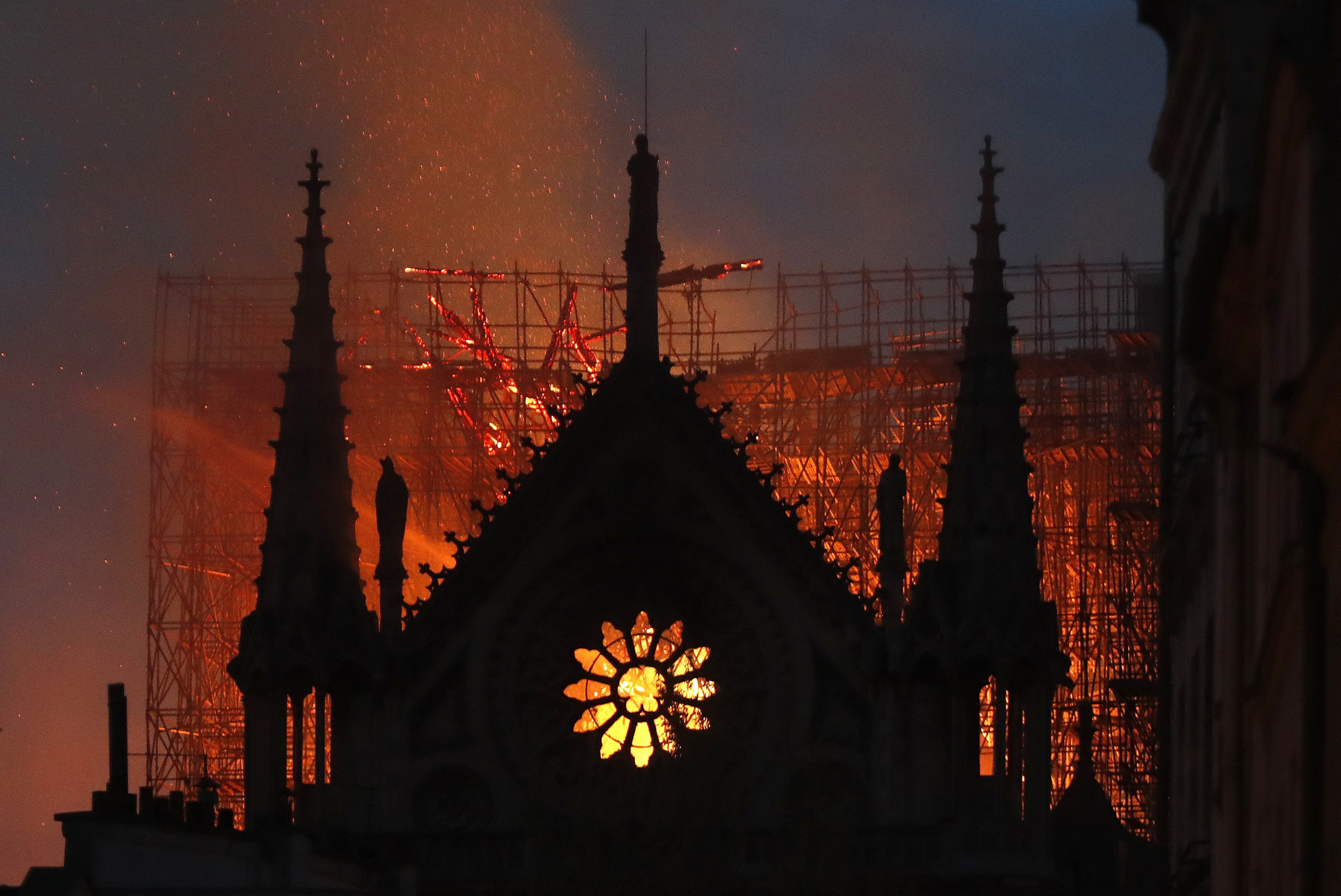 Flames and smoke rise from the Notre Dame cathedral as it burns in Paris, France, April 15, 2019. (AP Photo)