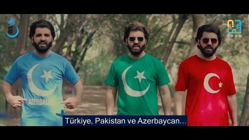 "A still shot from ""Saltanat e Usmania"" shows Noman Shah Bukhari wearing flag T-shirts of Azerbaijan, Pakistan and Turkey respectively. (AA Photo)"