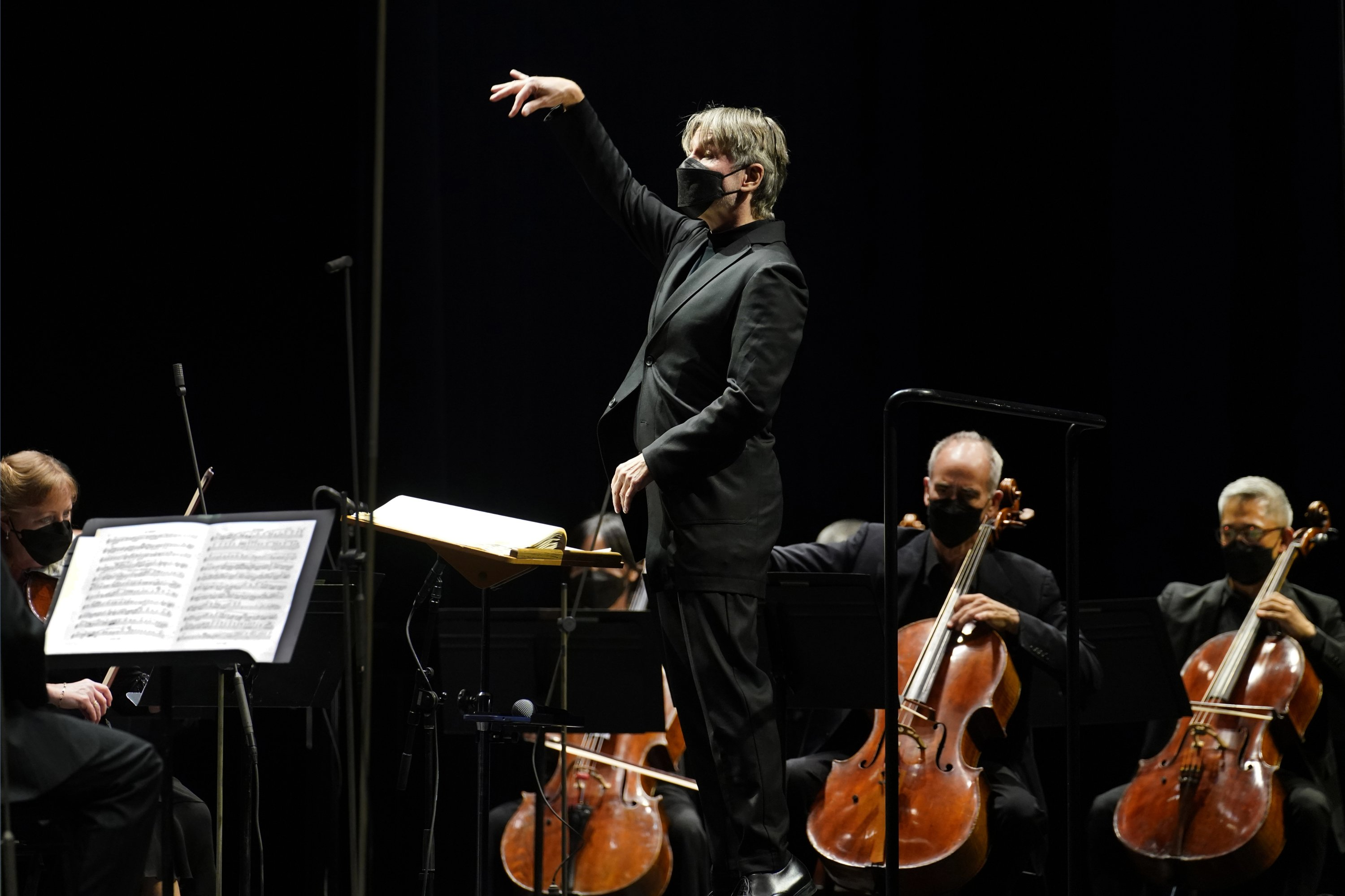 Guest conductor Essa-Pekka Salonen leads the New York Philharmonic as the orchestra performs before a live audience of 150 people for the first time since March at The Shed in Hudson Yards, New York, U.S., Wednesday, April 14, 2021. (AP Photo)