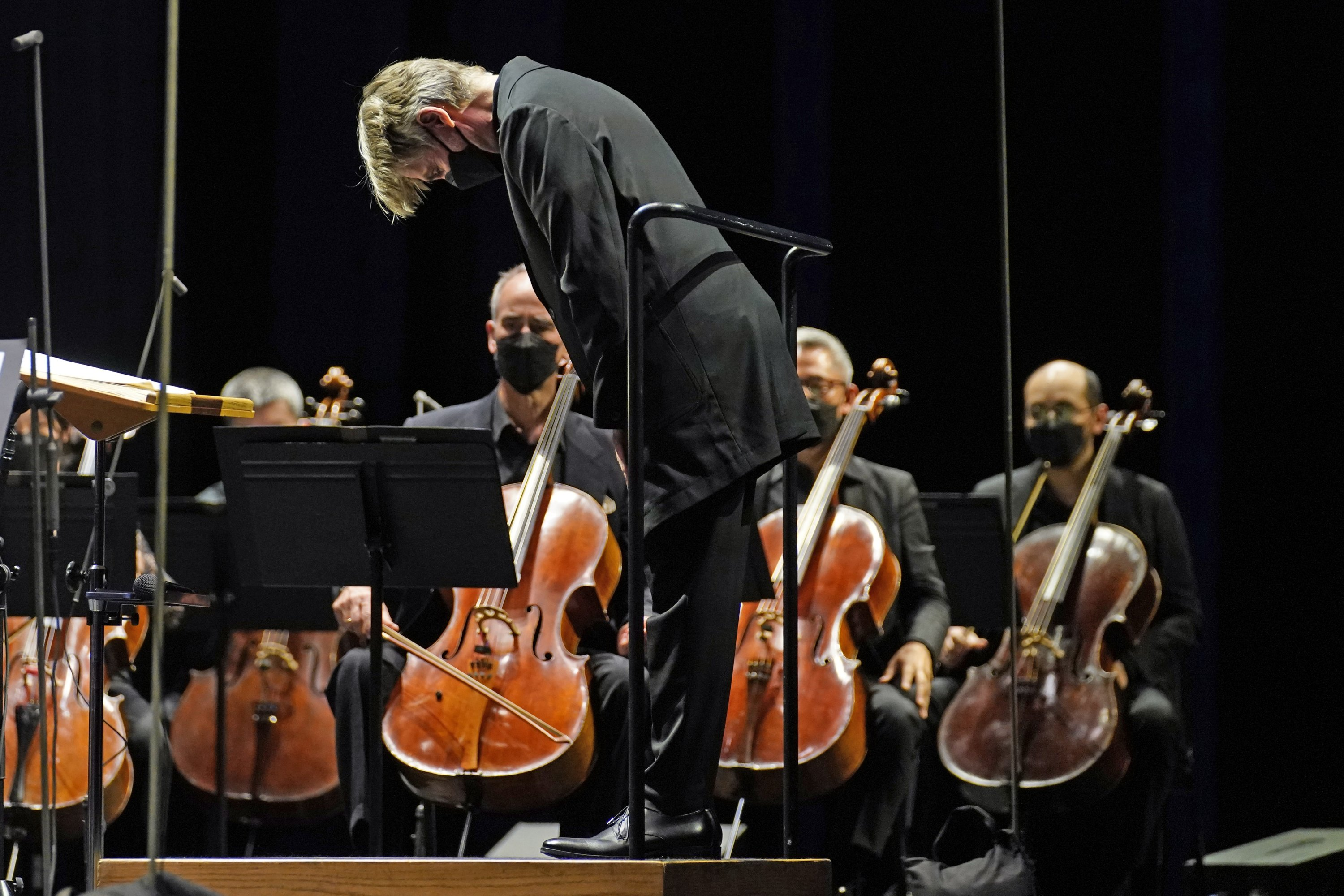 Guest conductor Essa-Pekka Salonen takes a bow before leading the New York Philharmonic in a performance in front of a live audience for the first time since March 10, 2020, at The Shed in Hudson Yards, New York, U.S., Wednesday, April 14, 2021. (AP Photo)