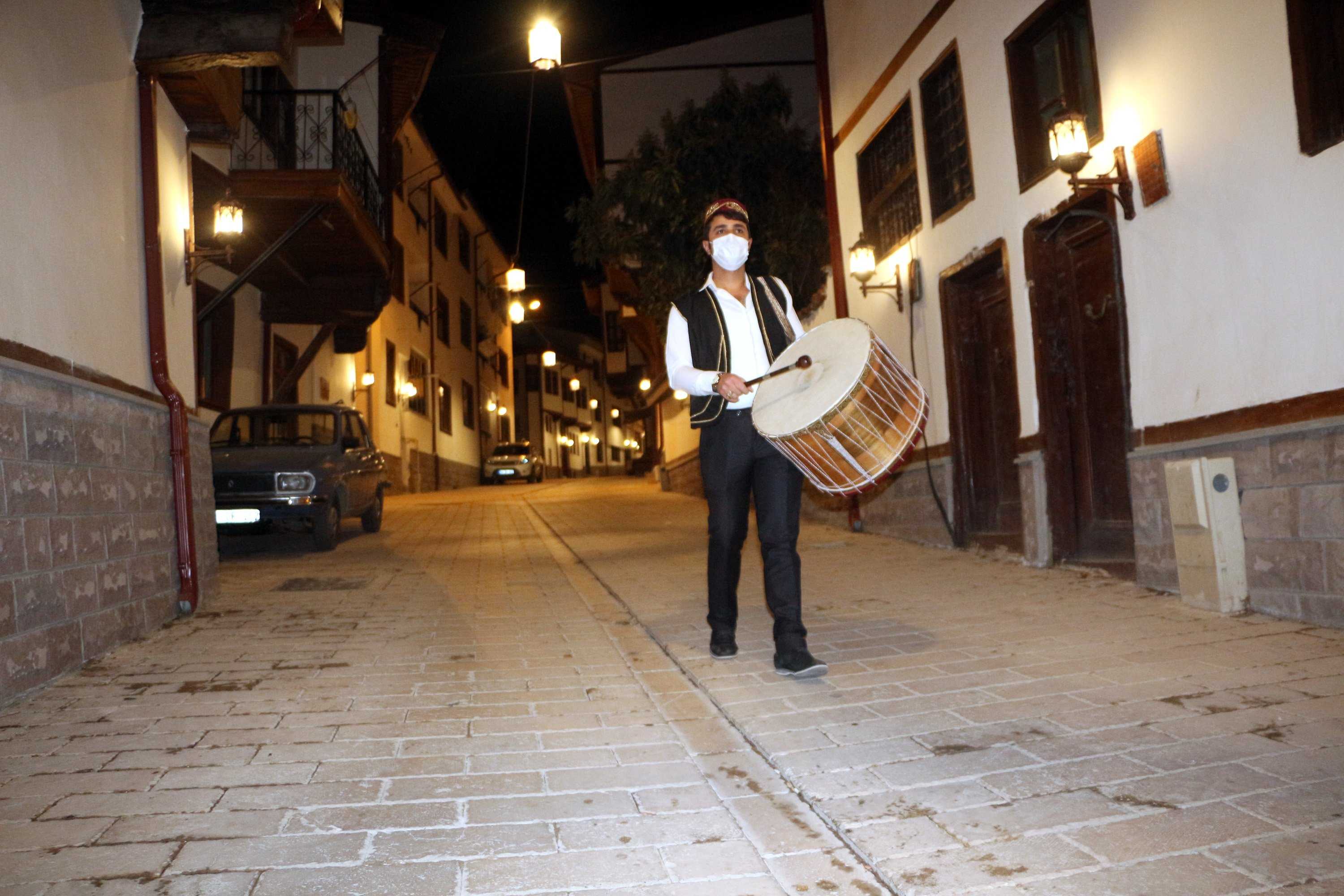 A dusk drummer wanders the streets while playing hand-held drums through the night, Tokat, Turkey, April 13, 2021. (DHA Photo)