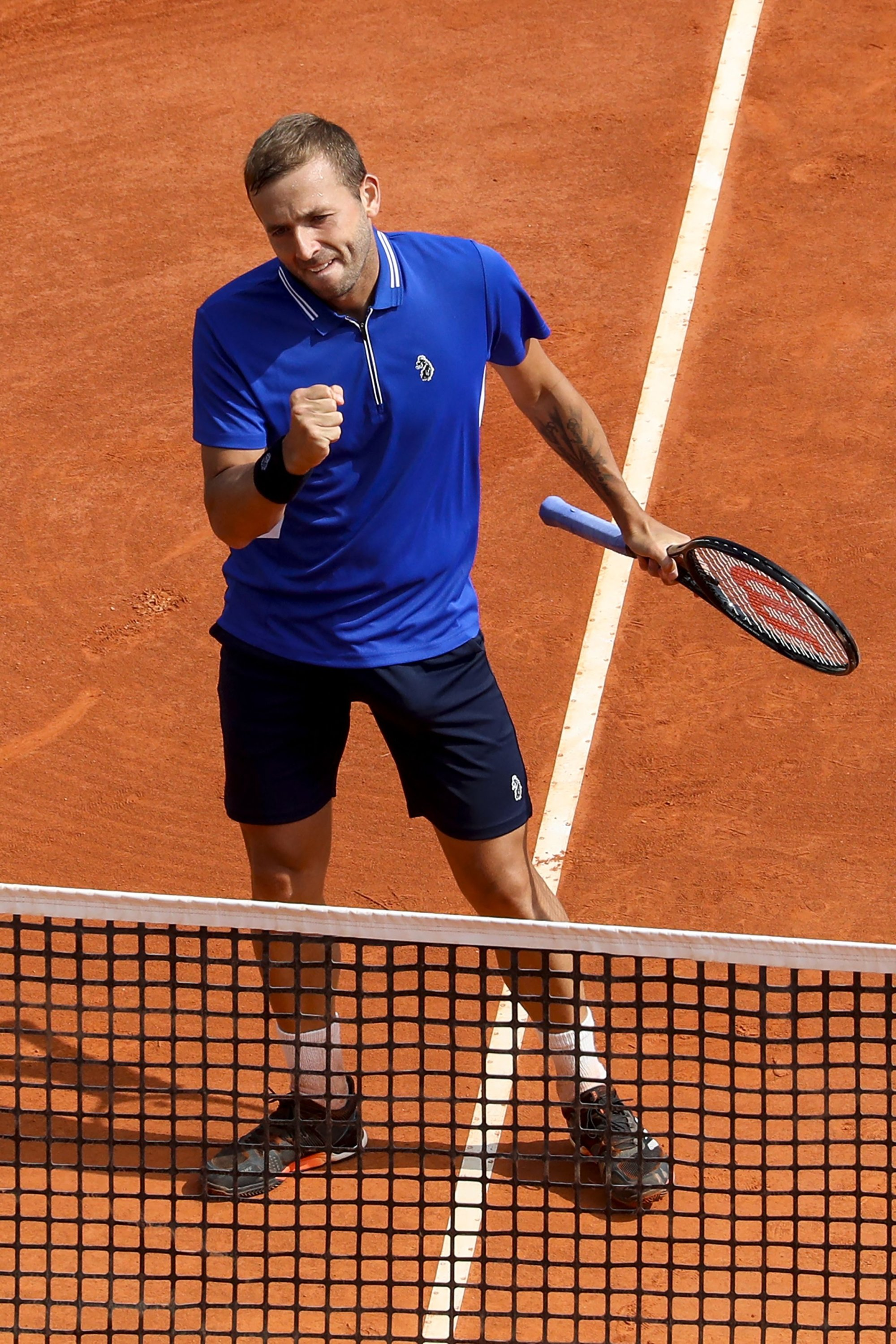 Britain's Daniel Evans celebrates winning his third-round singles match against Serbia's Novak Djokovic at the Monte Carlo Masters, in Monaco, April 15, 2021. (AFP Photo)