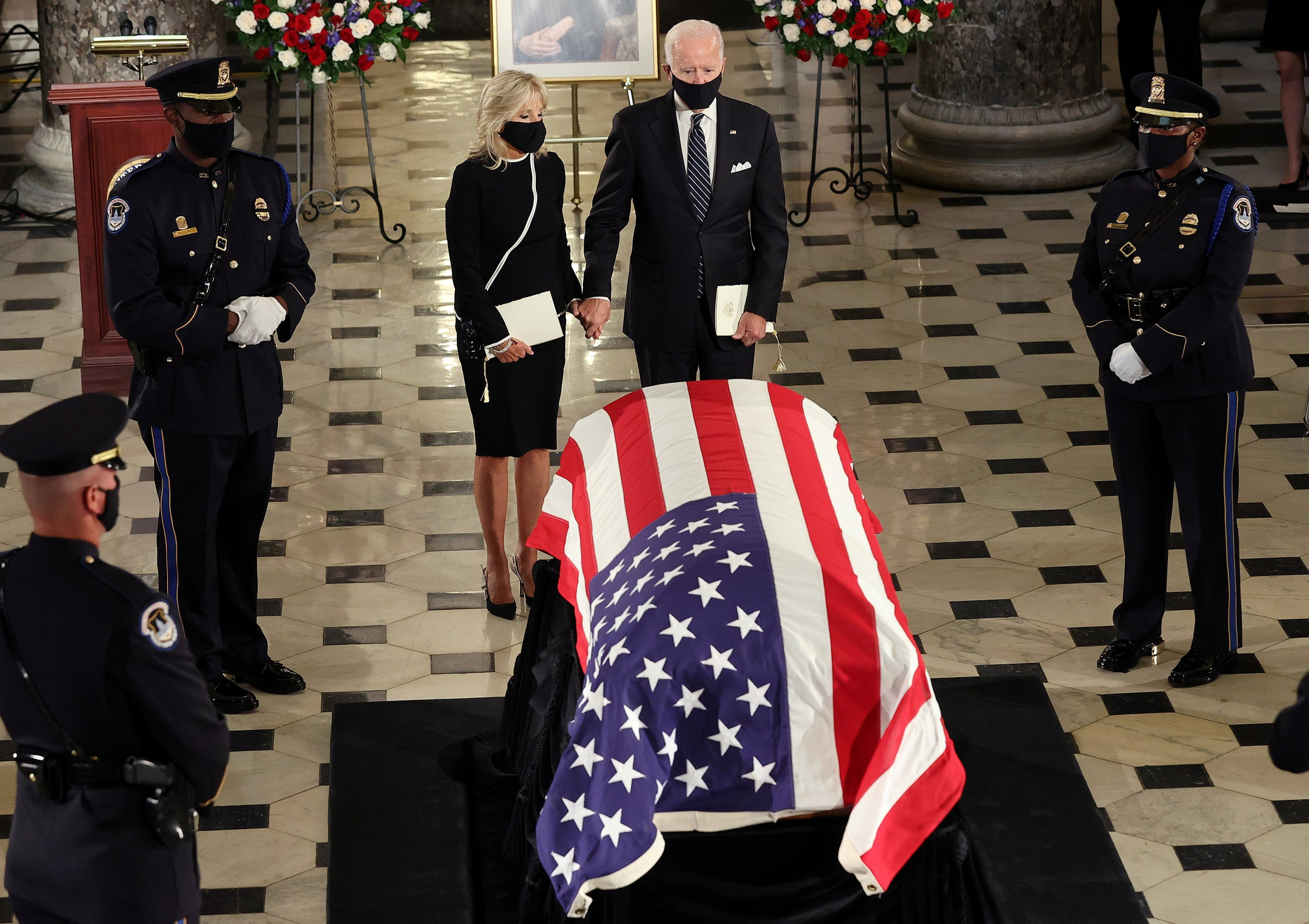 Jill Biden (C-L) and her husband, U.S. Democratic presidential candidate Joe Biden, pay their respects at a ceremony where U.S. Supreme Court Associate Justice Ruth Bader Ginsburg's flag-draped casket will lie in state in Statuary Hall at the Capitol, Washington, D.C, the U.S., Sept. 25, 2020. (Reuters Photo)