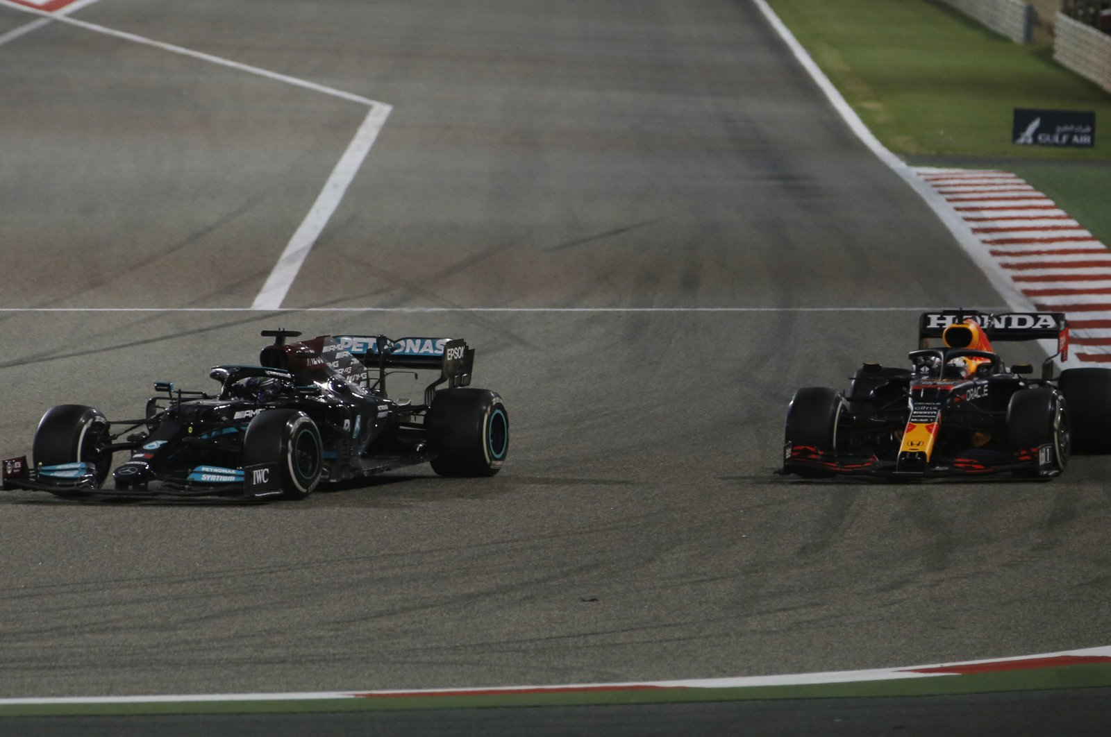 Mercedes' Lewis Hamilton (L) and Red Bull's Max Verstappen in action during Formula One Bahrain Grand Prix, Sakhir, Bahrain, March 28, 2021. (Reuters Photo)