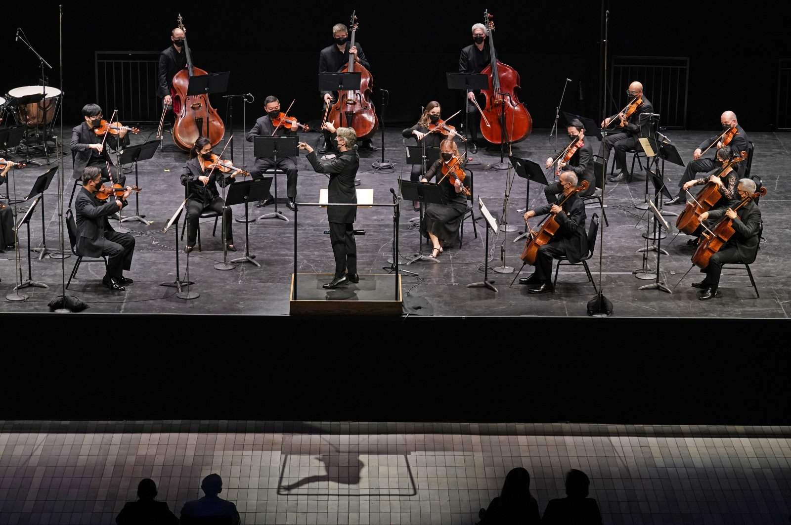 Essa-Pekka Salonen (C) leads the New York Philharmonic before an audience of 150 concertgoers at The Shed in Hudson Yards, New York, U.S., Wednesday, April 14, 2021. (AP Photo)