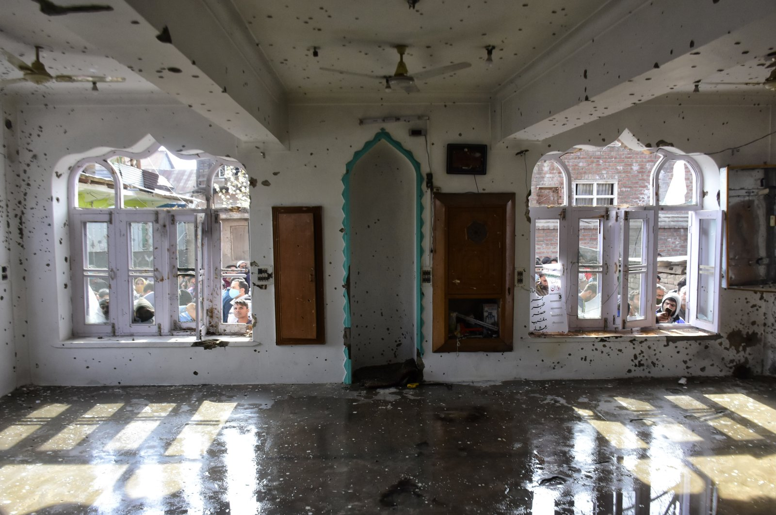 The interior of a mosque damaged in a clash between Indian forces and Kashmiri protestors, in the Shopian district of Indian-occupied Kashmir, April 9, 2021. (Photo by Getty Images)