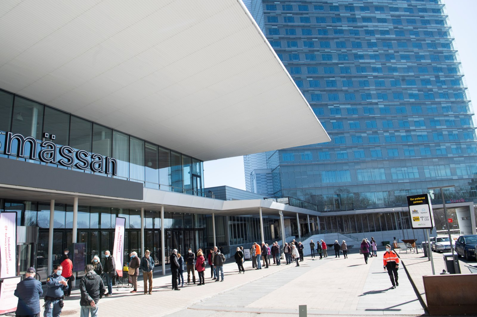 People stand in line to get a vaccine against the coronavirus outside the Stockholmsmassan exhibition center, turned mass vaccination center, in Stockholm, Sweden, Apr. 8, 2021. (REUTERS Photo)