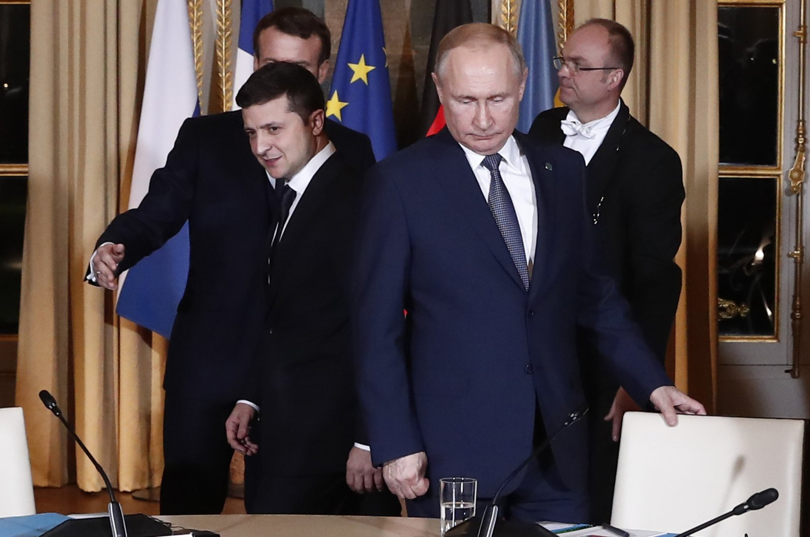 Russian President Vladimir Putin (R) and Ukrainian President Volodymyr Zelenskiy arrive for a working session at the Elysee Palace, Paris, France, Dec. 9, 2019. (AP Photo)