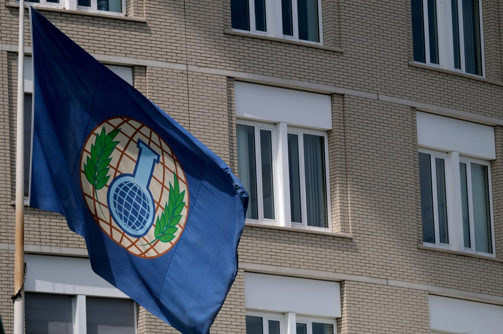 A logo of the Organisation for the Prohibition of Chemical Weapons (OPCW) is seen on a flag fluttering at the entrance of its headquarters building on June 24, 2020 in The Hague, Netherlands. (Getty Images)