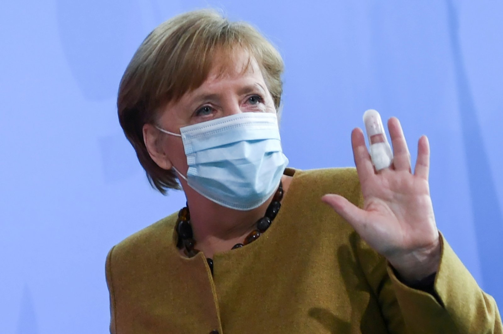 German Chancellor Angela Merkel gestures with a bandaged finger as she leaves after giving a statement, amid the coronavirus pandemic, Berlin, Germany, April 13, 2021. (Reuters Photo)