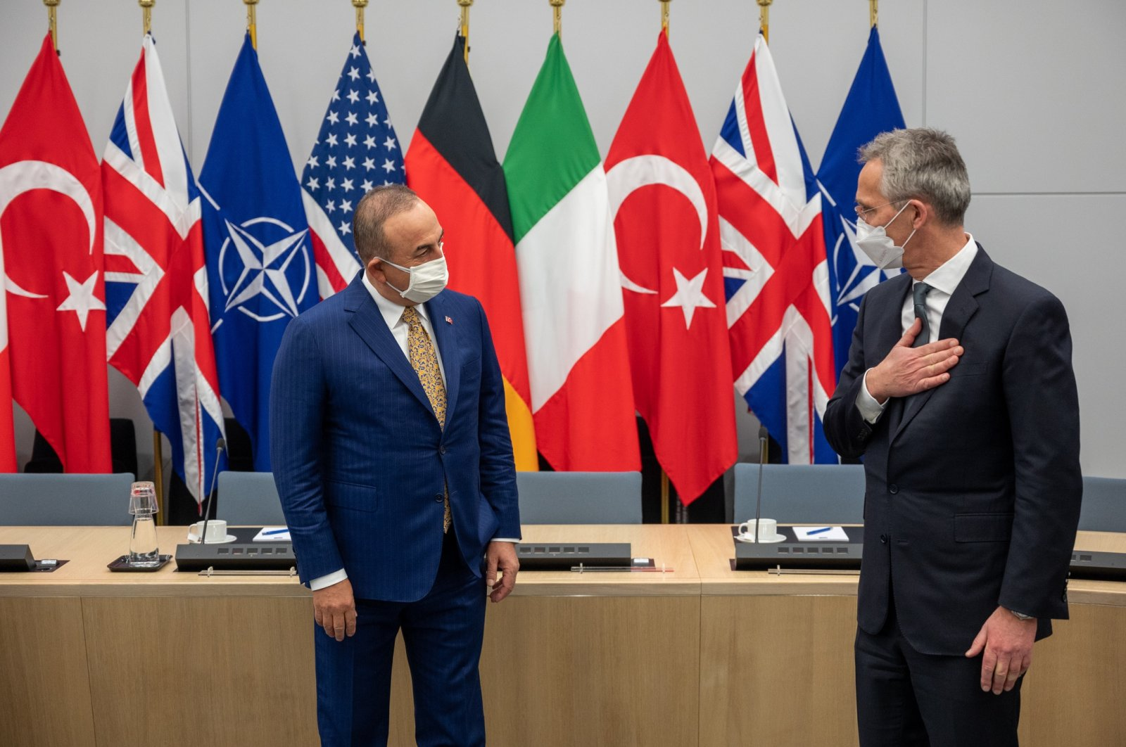 Foreign Minister Mevlüt Çavuşoğlu (R) and NATO chief Jens Stoltenberg greet each other on the sidelines of a NATO Council meeting on Afghanistan in Brussels, Belgium, Apr. 14, 2021. (AA Photo)