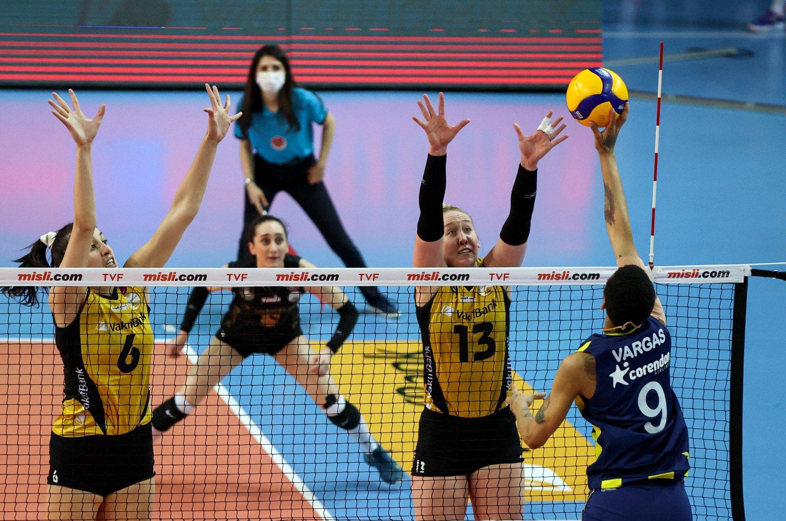 VakıfBank's Kübra Çalışkan (L, #6) and Mic Bartsch (2nd from R, #13) jump to make a play against Fenerbahçe Opet's Melissa Vargas (R, #9) during a Misli.com Sultans' League playoff game in Istanbul, Turkey, April 13, 2021. (AA Photo)