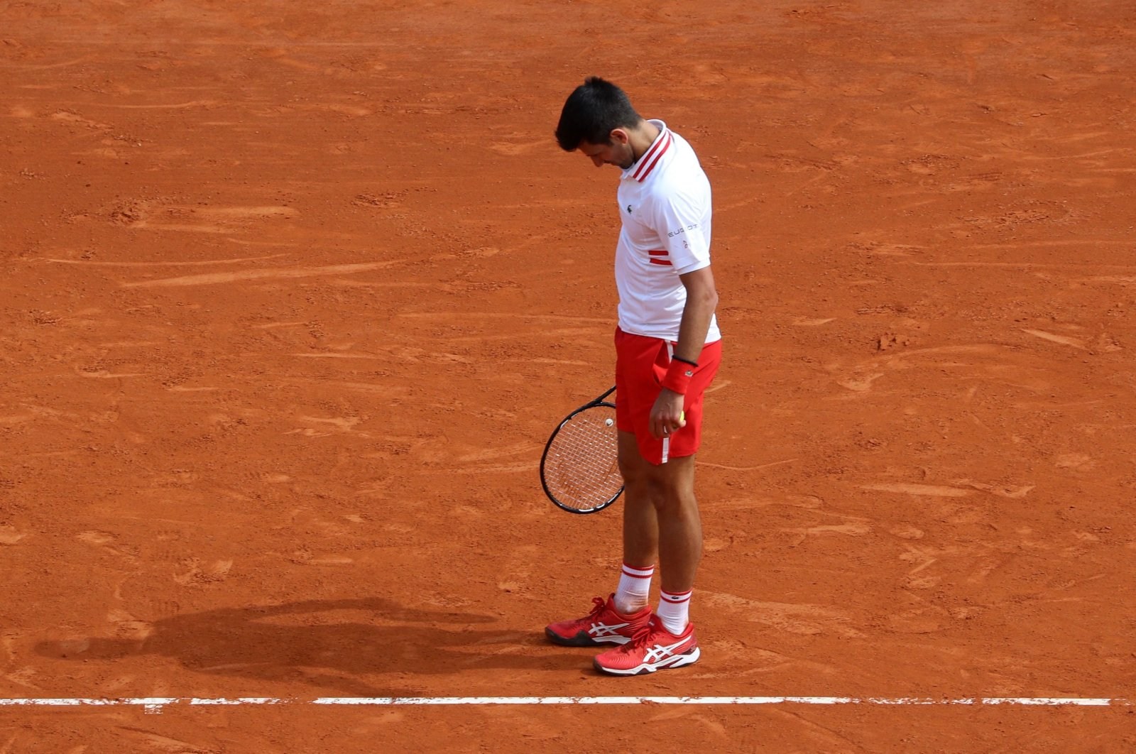 Serbia's Novak Djokovic reacts during his third-round singles match against Britain's Daniel Evans at the Monte-Carlo ATP Masters, Monaco, April 15, 2021. (AFP Photo)