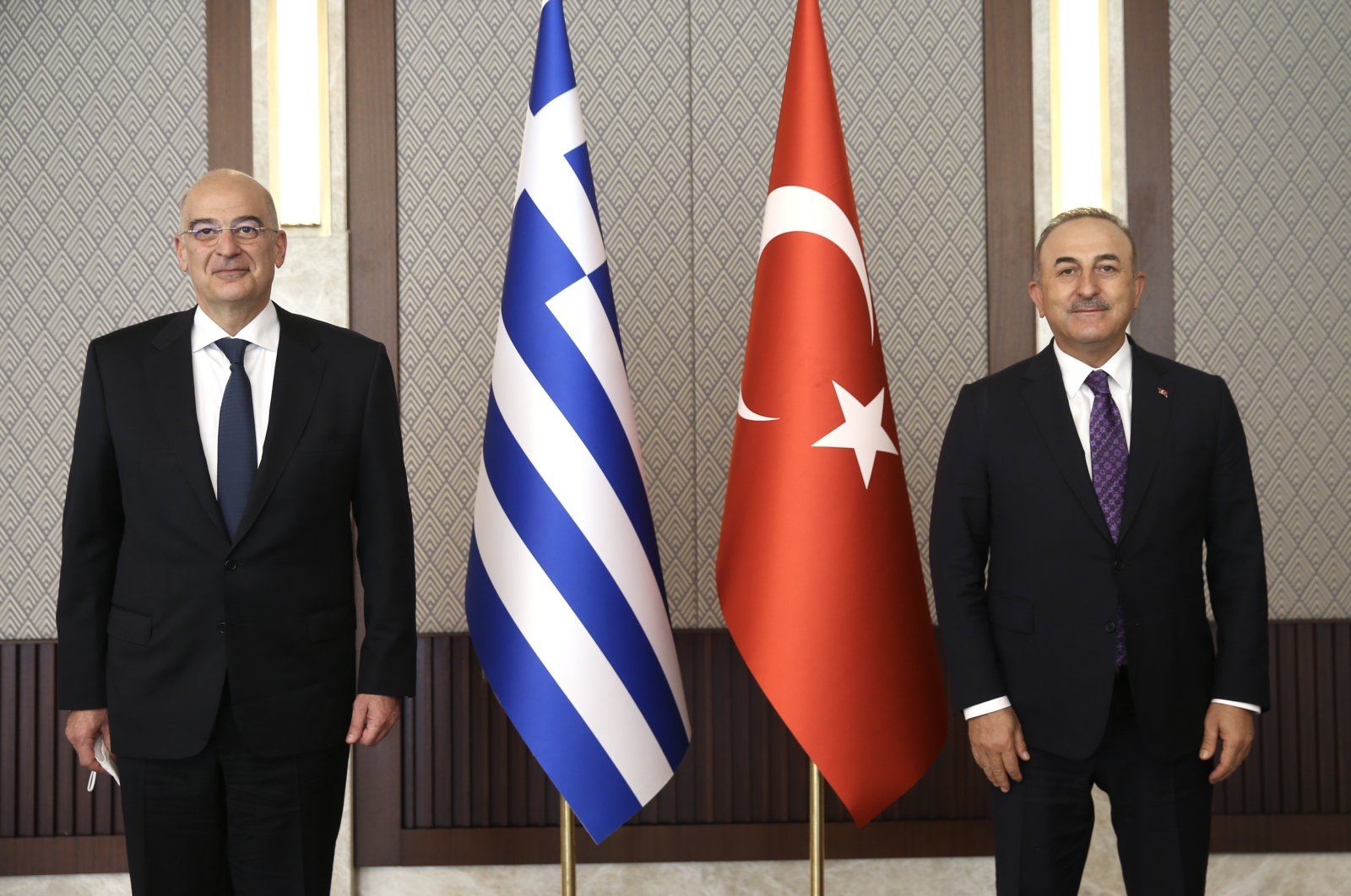 Greek Foreign Minister Nikos Dendias (L) and Turkish Foreign Minister Mevlüt Çavuşoğlu pose for a photo prior to their meeting in Ankara, Turkey, April 15, 2021. (Photo made available by the Turkish Foreign Ministry's press office/EPA Photo)