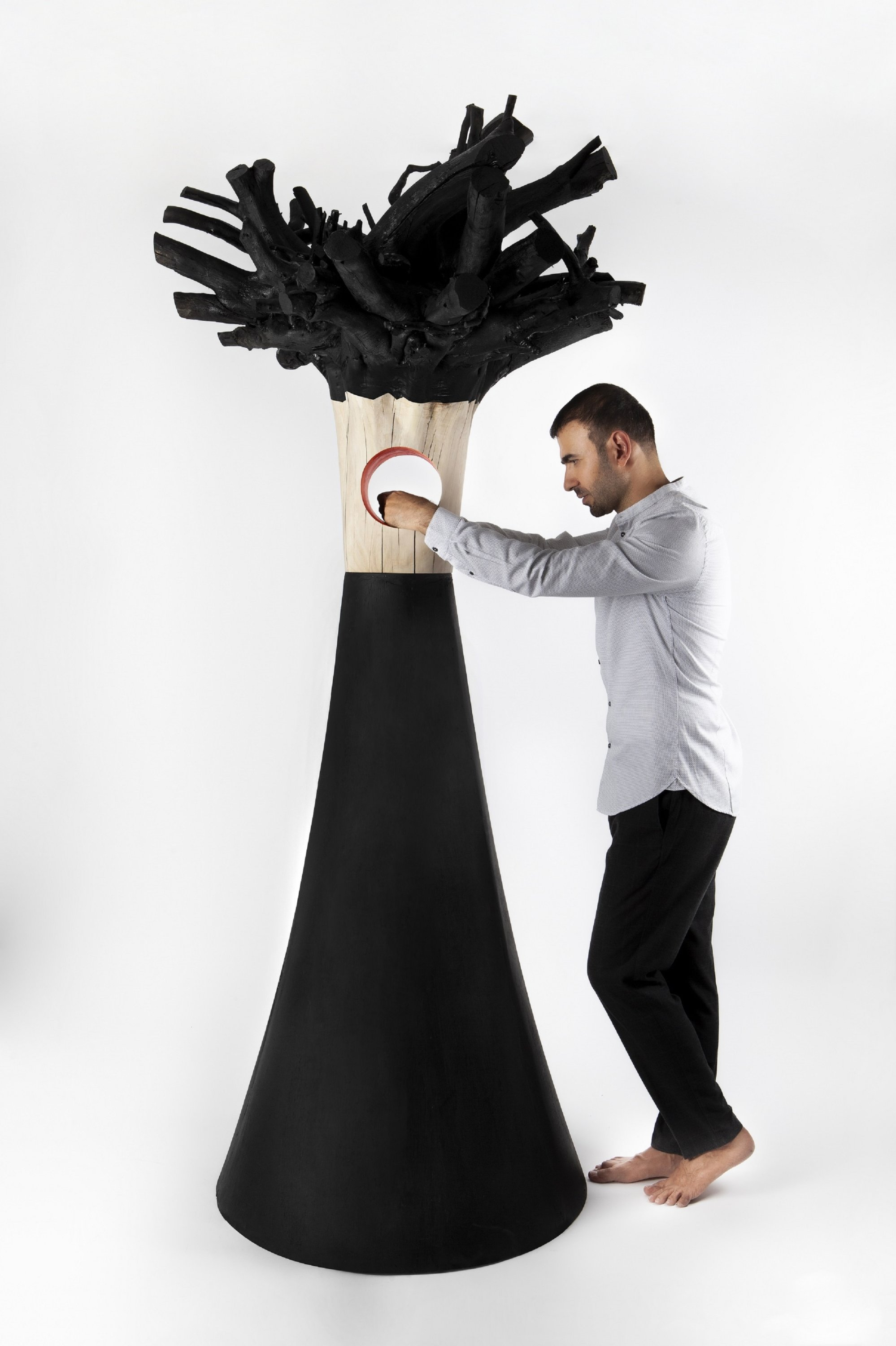 Ahmed Yajidar stands with one of his amorphous statues from