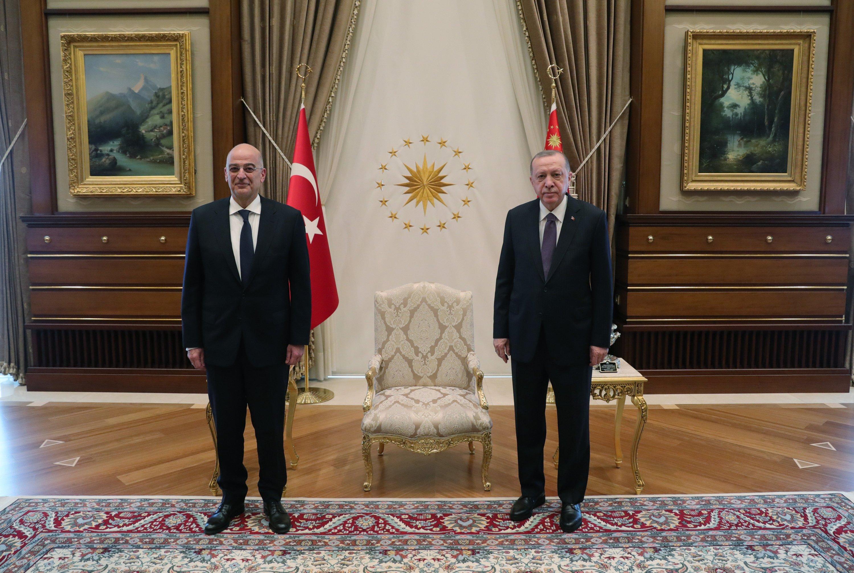 Greek Foreign Minister Nikos Dendias (L) and President Recep Tayyip Erdoğan meet in Ankara, Turkey, April 15, 2021. (AA)