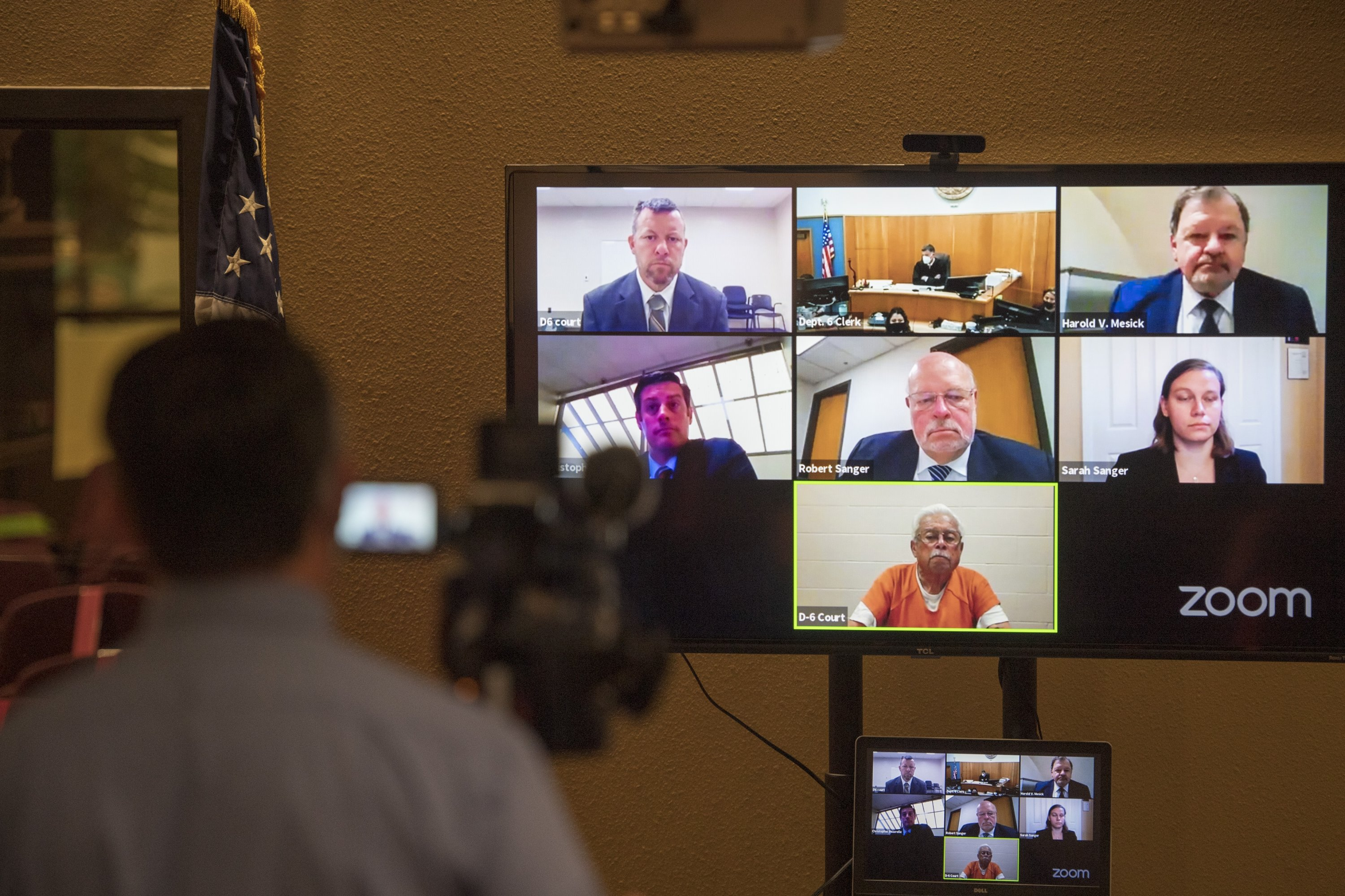 Defendants Paul Flores (T-L), and his father Ruben Flores (B-C), appear via videoconference during their arraignment, in San Luis Obispo Superior Court in San Luis Obispo, California, U.S., April 15, 2021. (AP Photo)