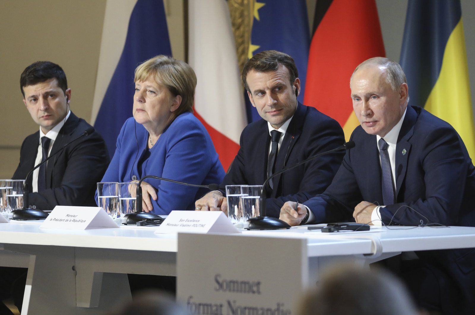 From left to right, Ukrainian President Volodymyr Zelenskiy, German Chancellor Angela Merkel, French President Emmanuel Macron and Russian President Vladimir Putin attend a joint news conference at the Elysee Palace in Paris, France, Dec. 9, 2019. (AP Photo)