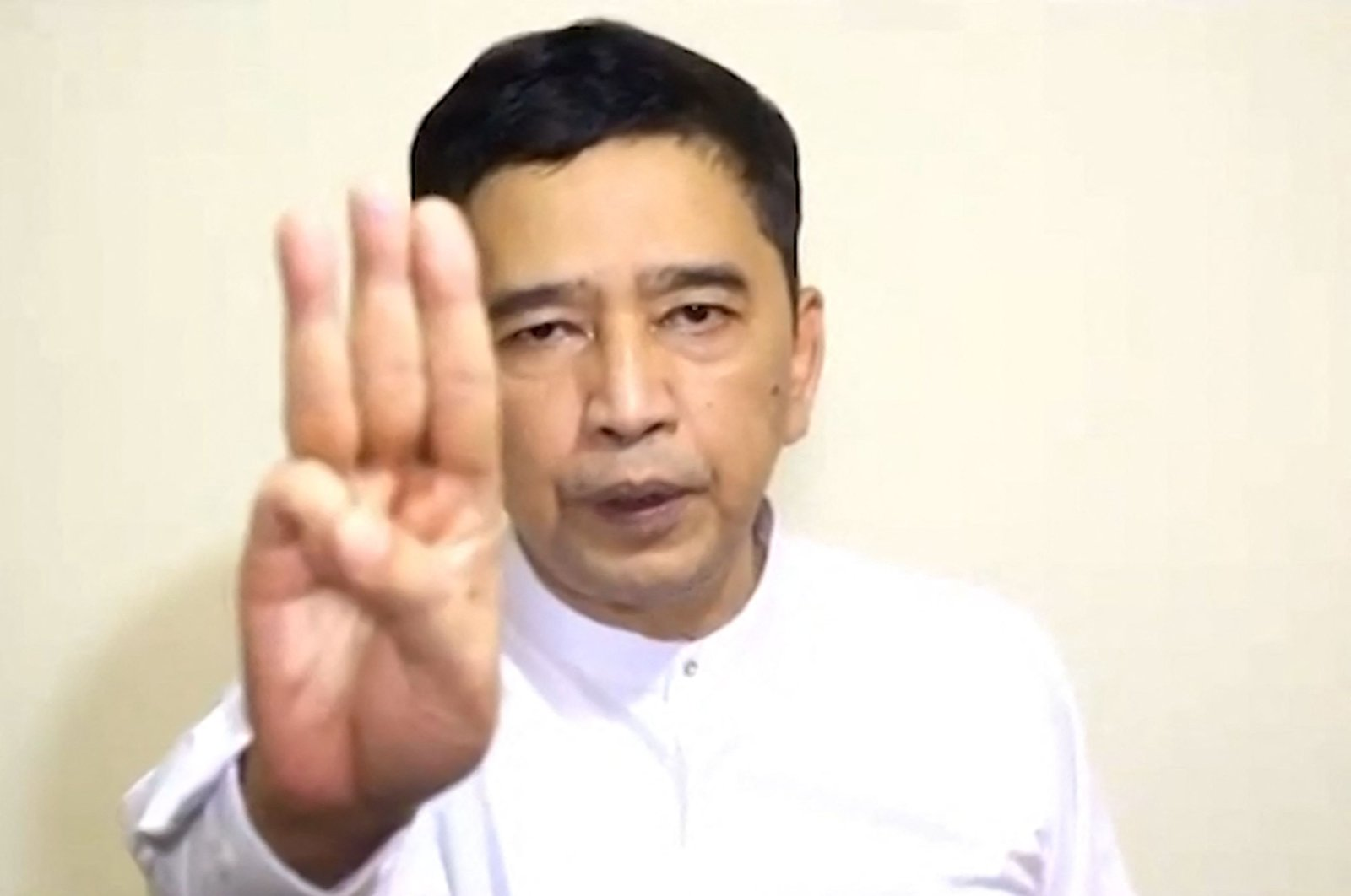 This screengrab from a video shows Min Ko Naing, prominent pro-democracy leader in an undisclosed location holding up the three finger salute as he announces the formation of a National Unity Government, April 16, 2021. (Committee for Representing Pyidaungsu Hluttaw - CRPH via  AFP)