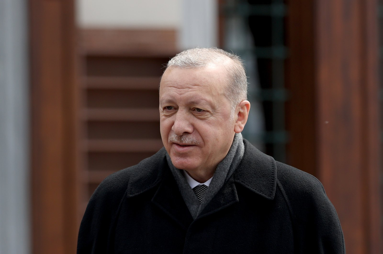 President Recep Tayyip Erdoğan speaks with reporters following Friday prayers in Istanbul, Turkey, April 16, 2021. (AA)