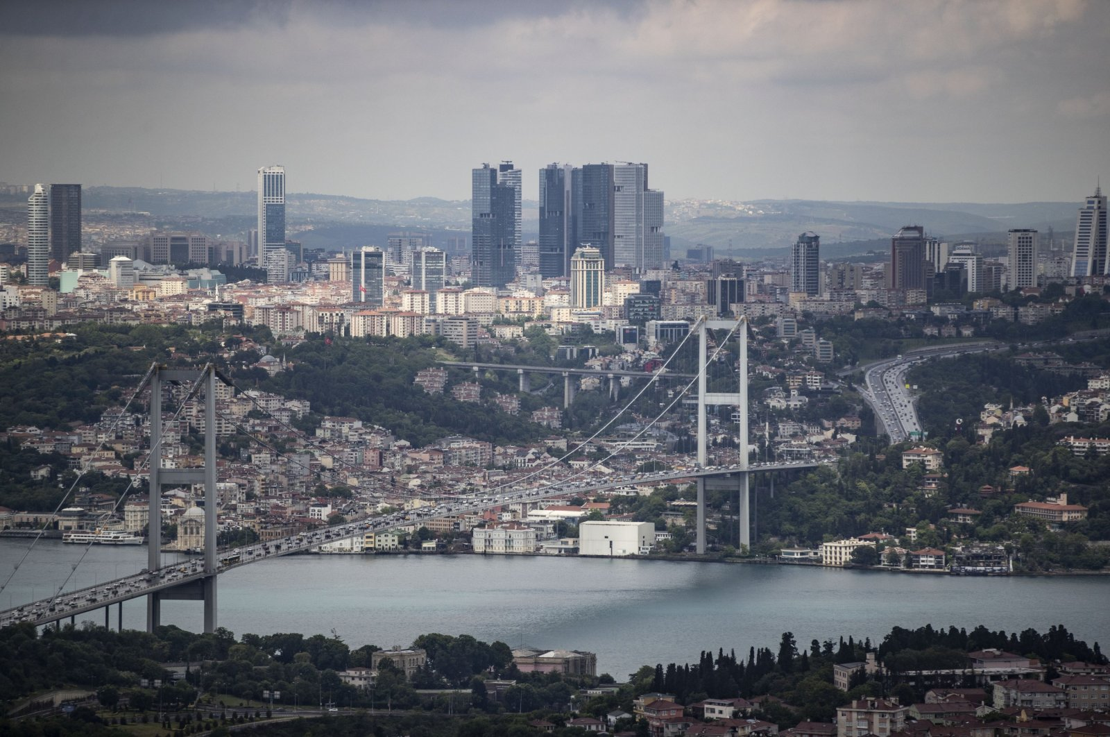 A general view of the July 15 Martyrs Bridge, formerly known as the Bosporus Bridge, and surrounding buildings and skyscrapers, Istanbul, Turkey, May 28, 2020. (AA Photo)