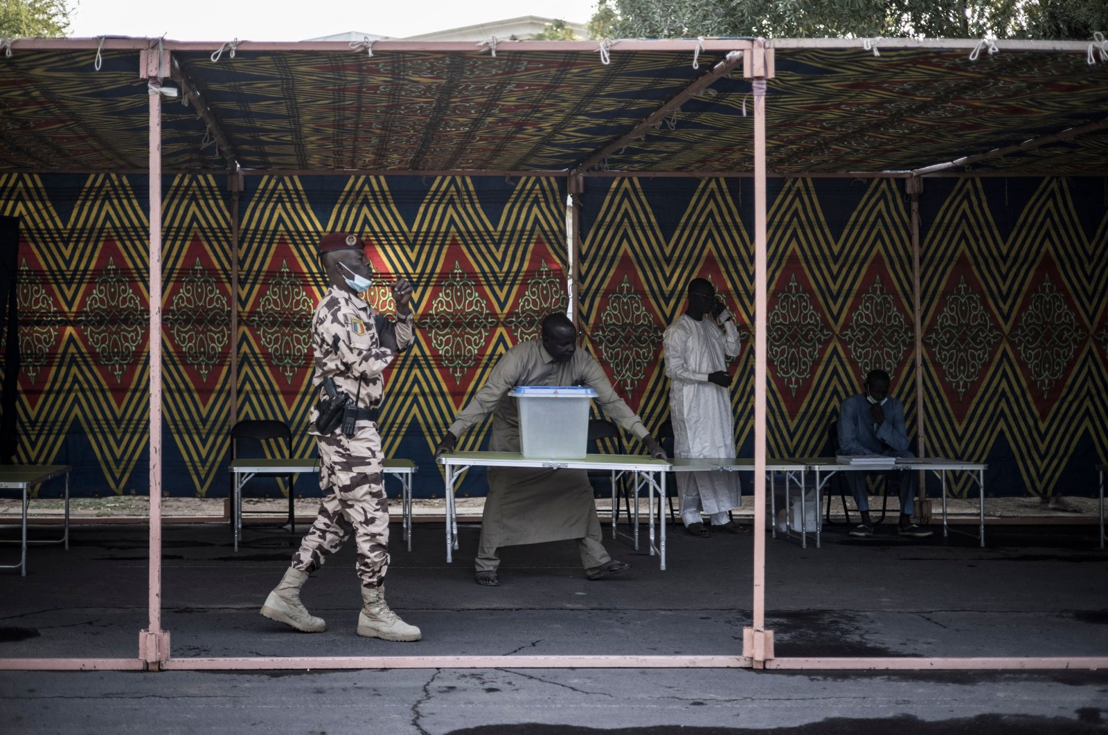 Polling station officials prepare for Chad President Idriss Deby Itno to vote in N'djamena, Chad, April 11, 2021. (AFP Photo)