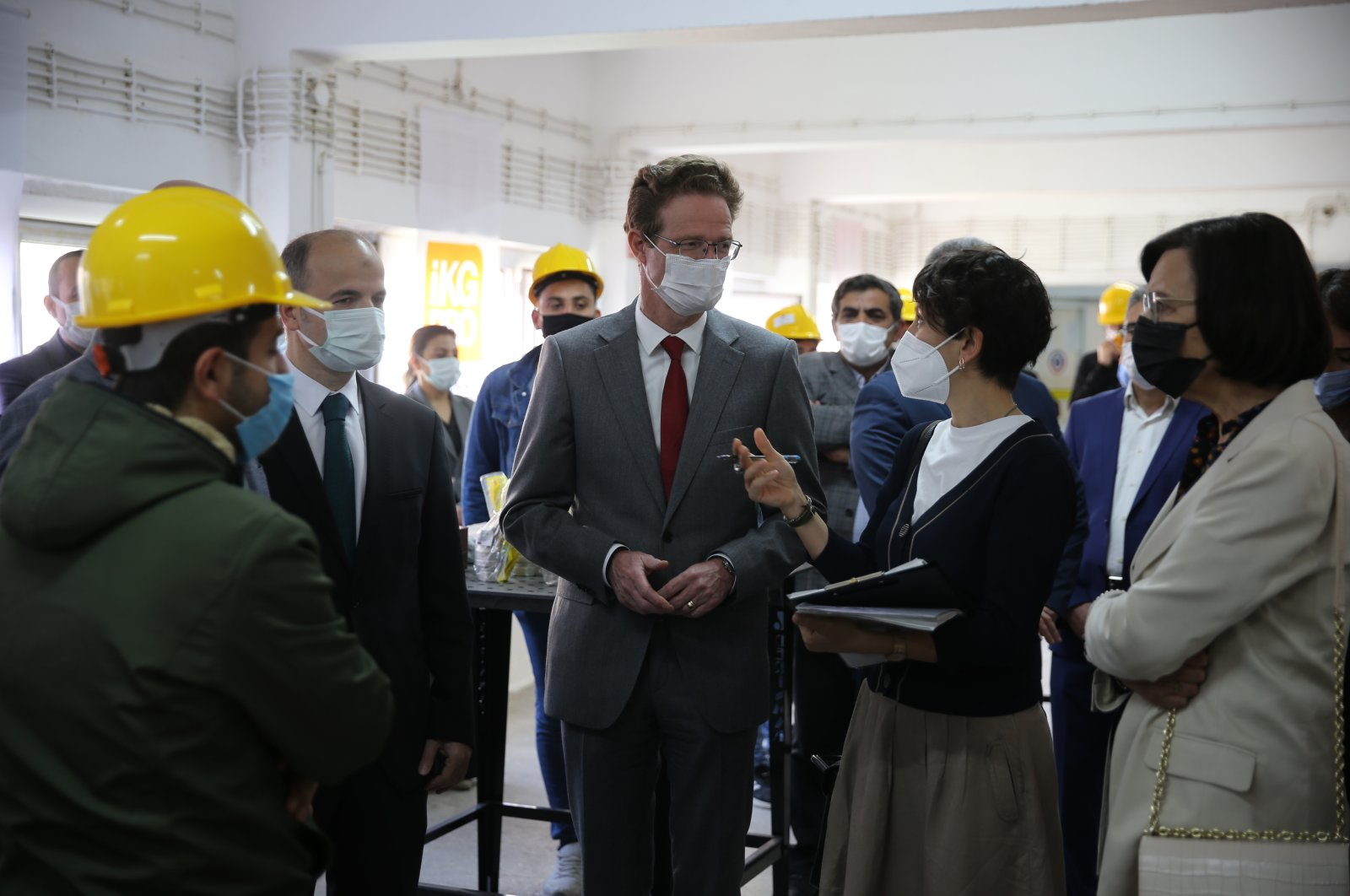 "EU head of delegation to Turkey Nikolaus Meyer-Landrut meeting vocational high school students training in ""interior natural gas piping"" as part of the ""Technical Assistance Project for Encouraging Youth Employment in the TRC3 Region"" project in Mardin, Turkey, April 16, 2021. (AA Photo)"