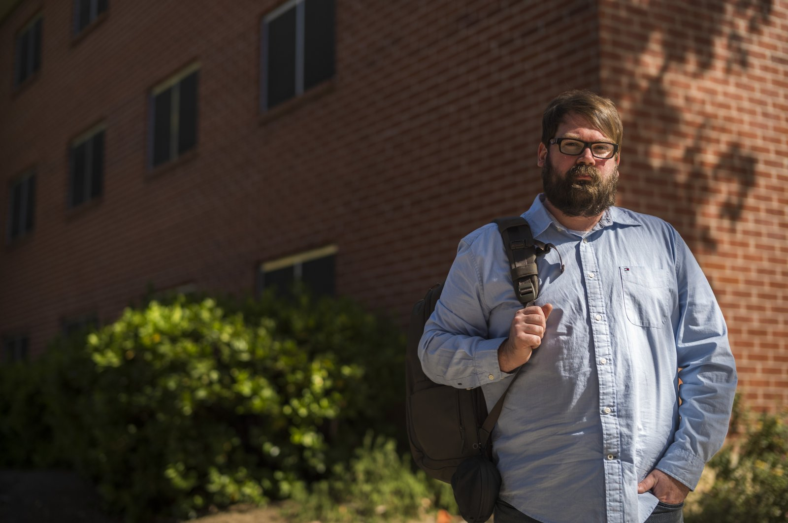 Chris Lambert, a musician and recording engineer, poses for a photograph, in front of Muir Hall dormitory at California Polytechnic University in San Luis Obispo, California, U.S., April 15, 2021. (AP Photo)