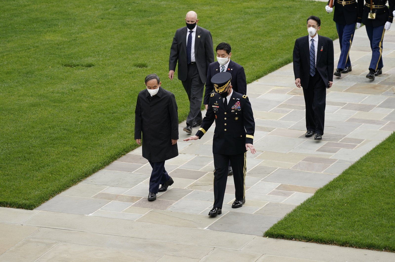 Japanese Prime Minister Yoshihide Suga at the Tomb of the Unknown Soldier for a wreath laying ceremony with U.S. Army Maj. Gen. Omar Jones at Arlington National Cemetery in Arlington, Virginia, U.S., April 16, 2021. (AP Photo)