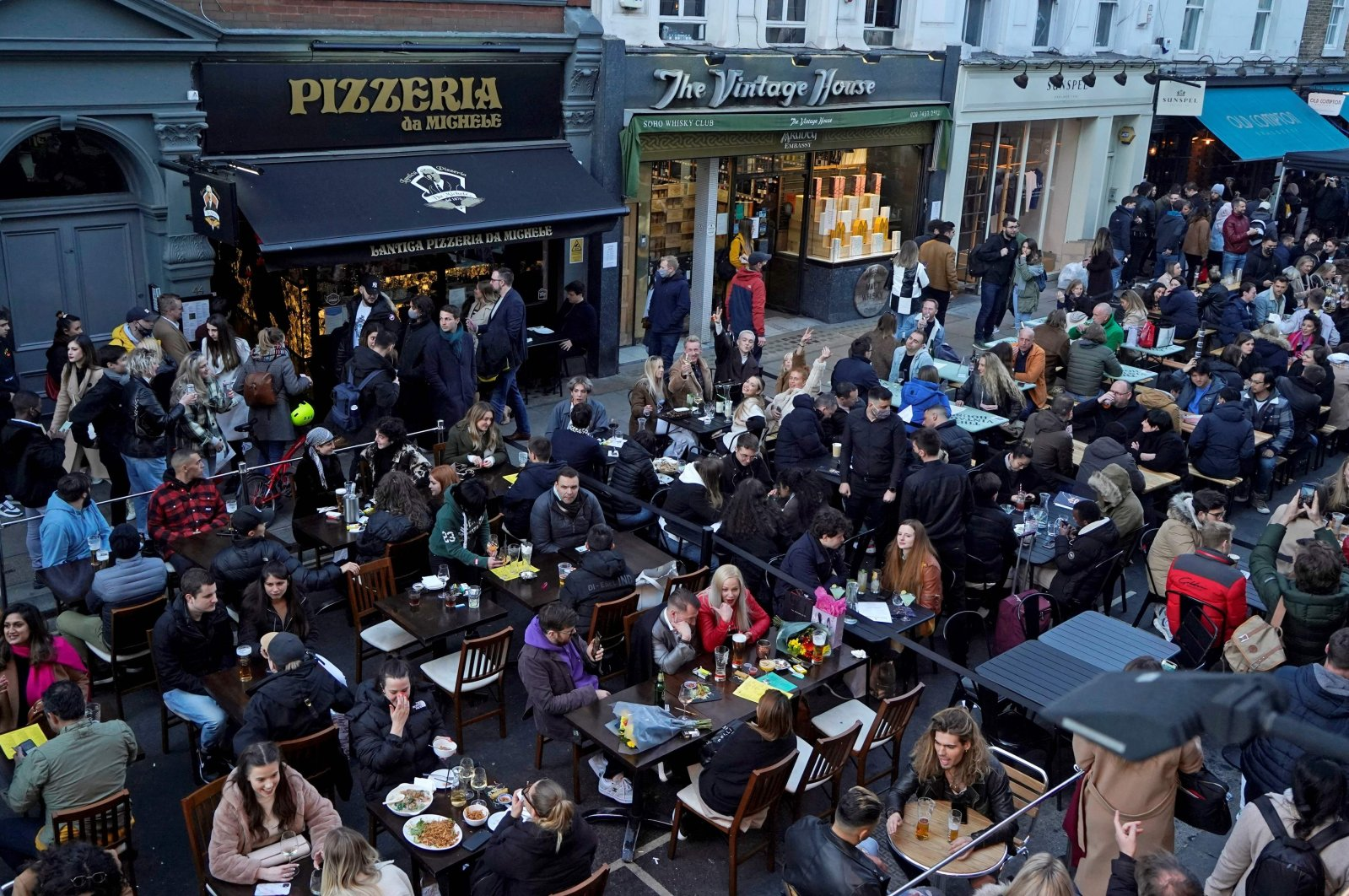 People eating and drinking in London's Soho following step two of the British government's roadmap out of England's third national lockdown, London, U.K., April 16, 2021 (AFP Photo)