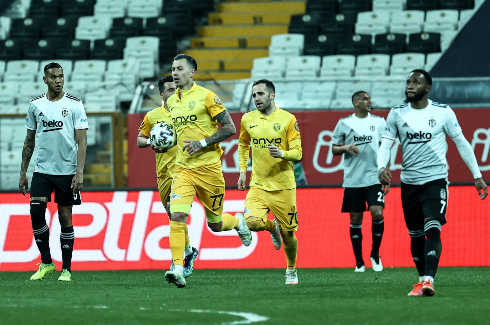 MKE Ankaragücü footballer Emre Güral sprints to the middle of the field with the ball after his team scored a penalty goal against Beşiktaş in a match that ended 2-2 at the Vodafone Arena, Istanbul, Turkey, April 16, 2021. (AA Photo)