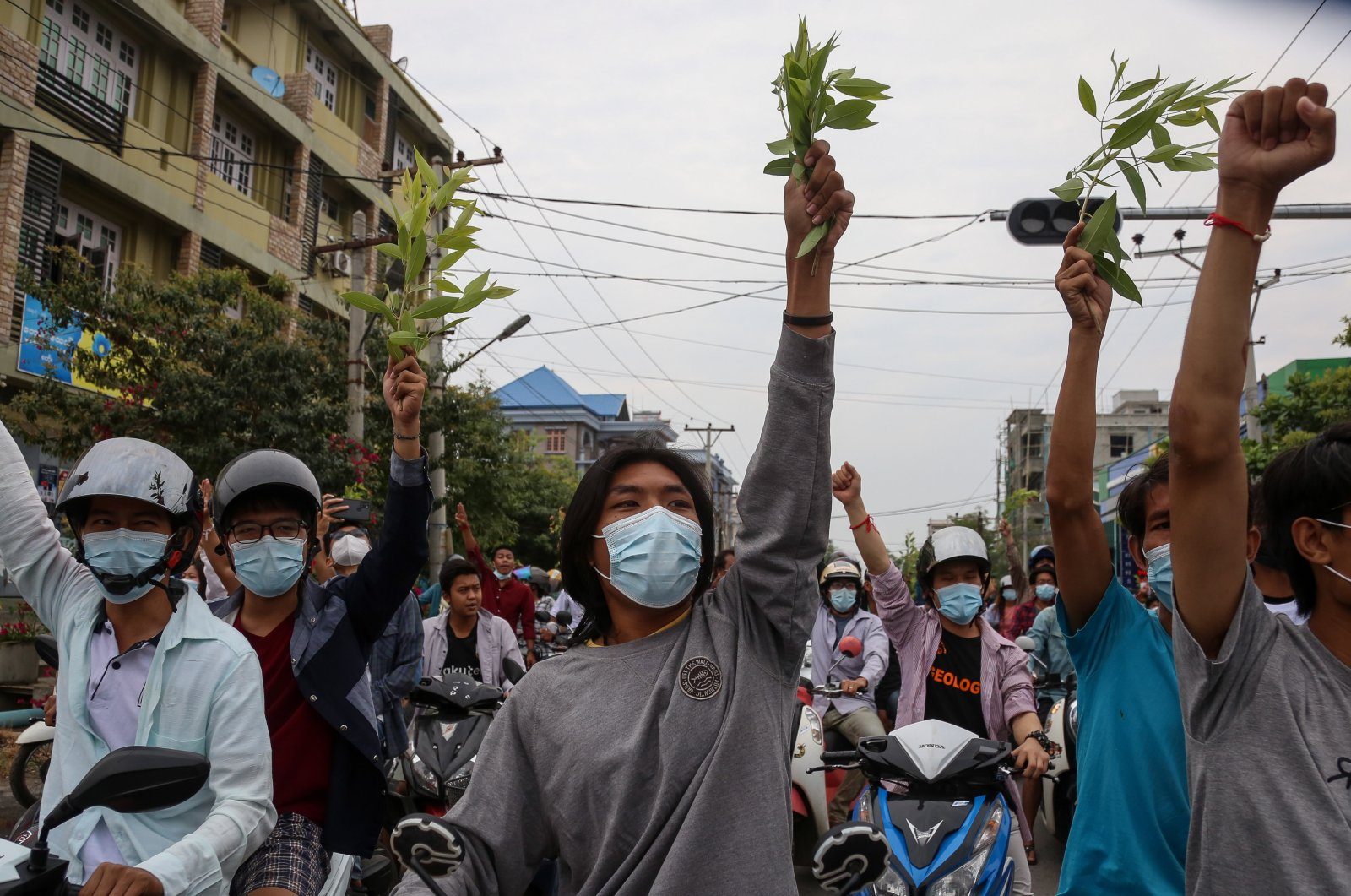 Demonstrators raise their fists during an anti-military coup protest in Mandalay, Myanmar, April 17, 2021. (EPA Photo)