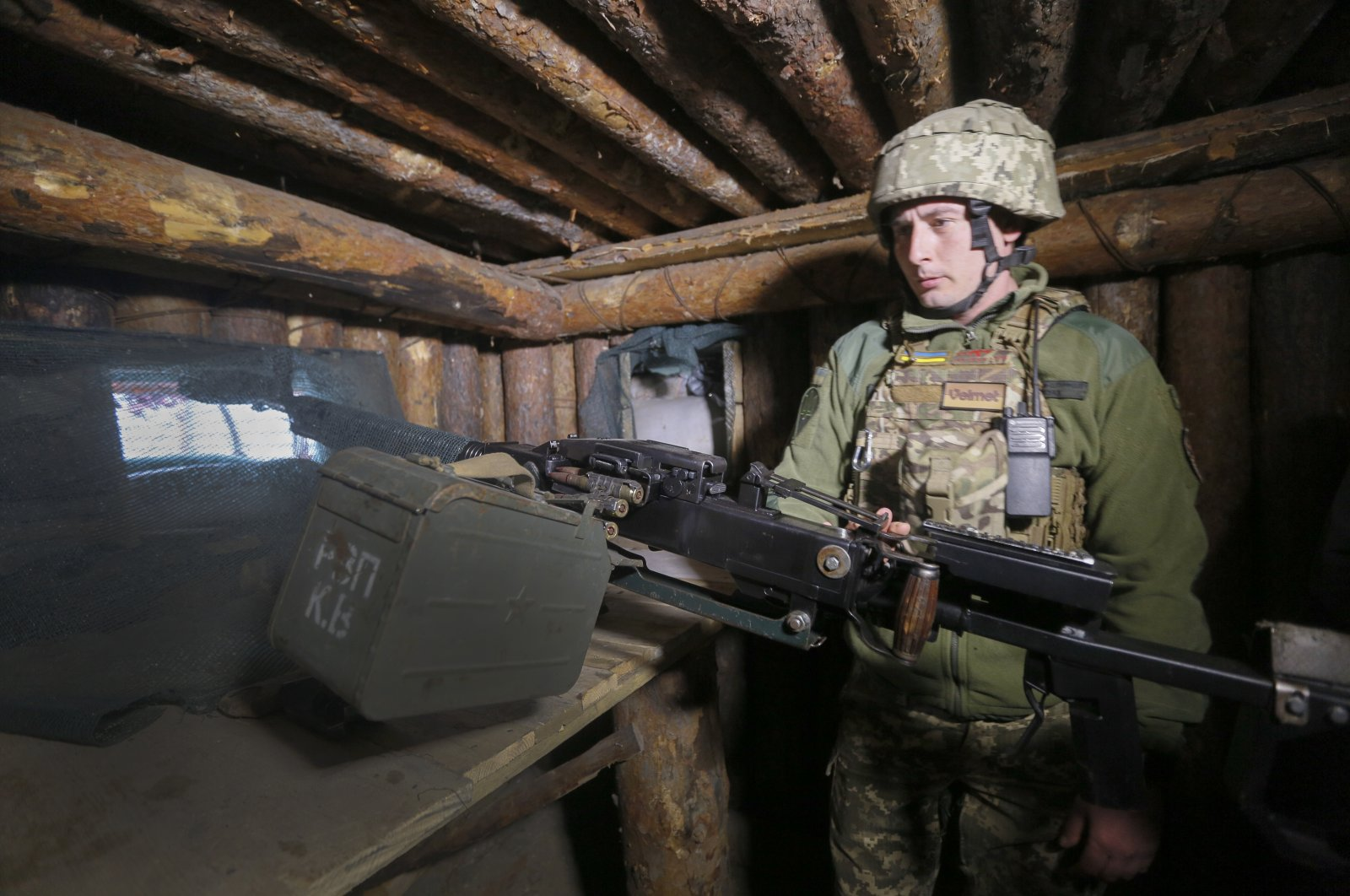 A Ukrainian soldier is seen at a fighting position on the line of separation from Russian-backed rebels near Luhansk, Ukraine, April 16, 2021. (AP Photo)