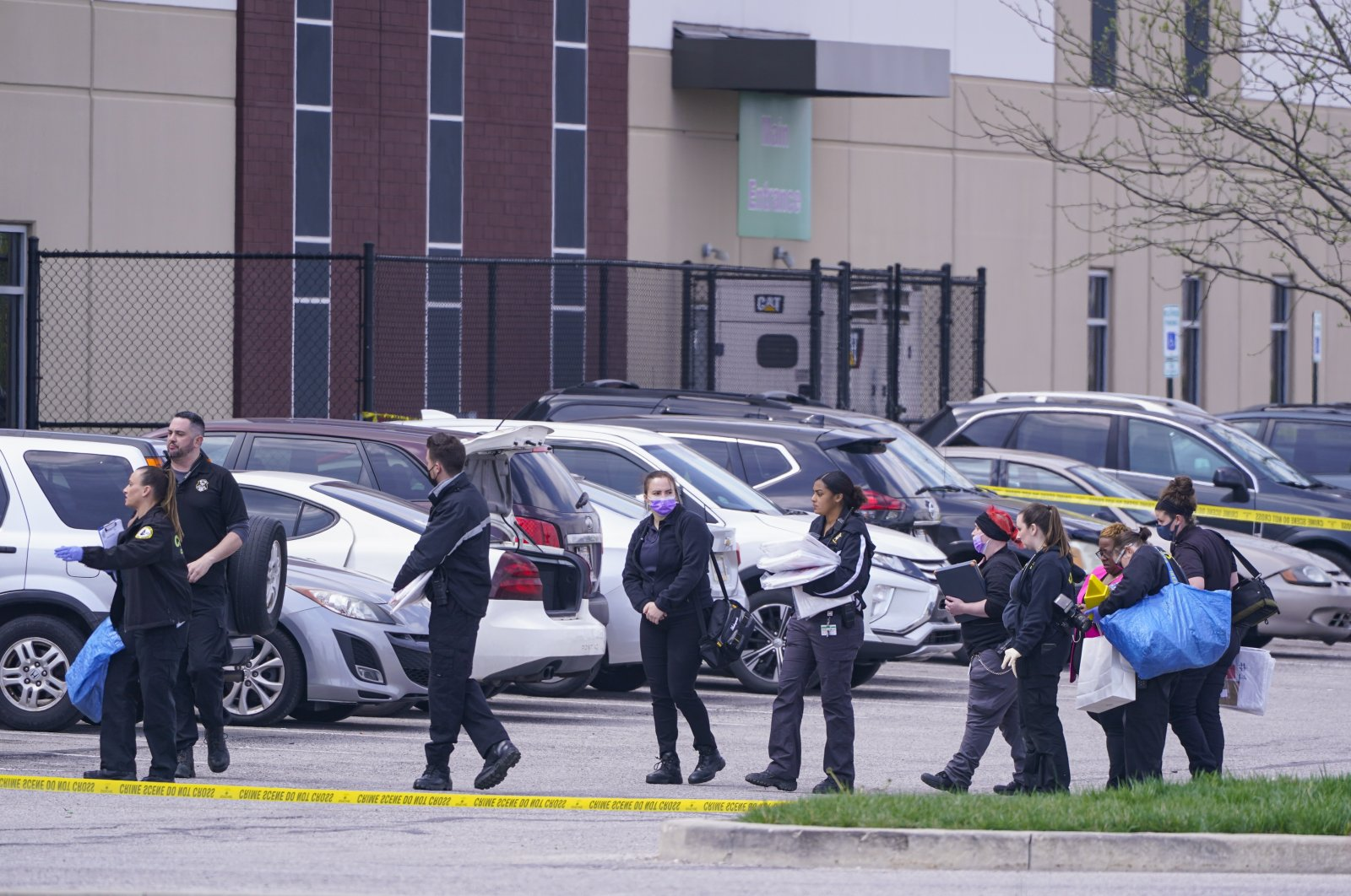 Law enforcement confer at the scene in Indianapolis, where multiple people were shot at a FedEx Ground facility near the Indianapolis airport, U.S., April 16, 2021. (AP Photo)