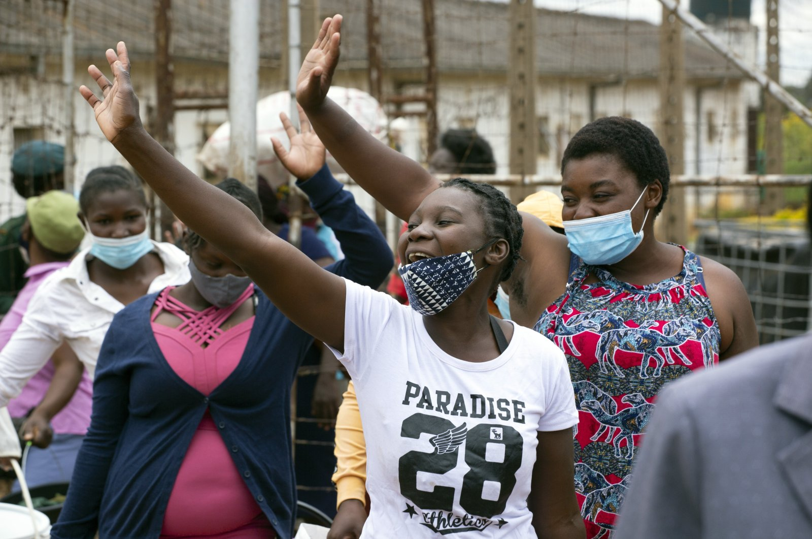 Female prisoners wave goodbye to their fellow inmates following their release from Chikurubi prison on the outskirts of Harare, Zimbabwe, April 17, 2021. (AP Photo)
