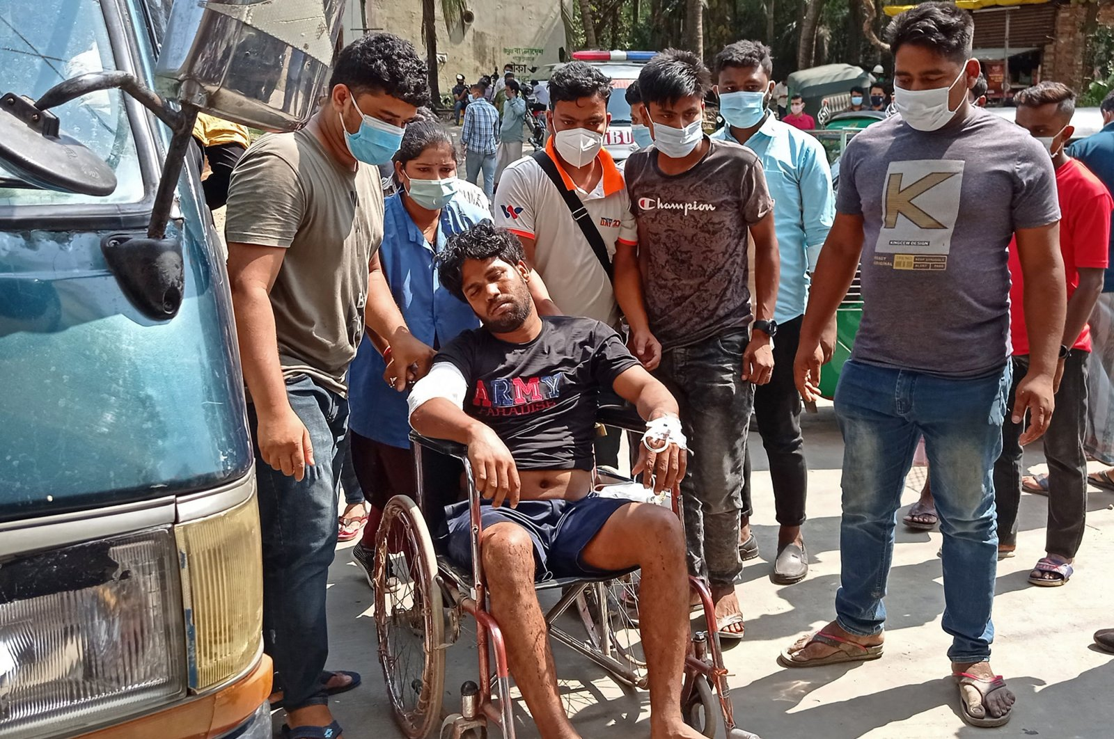 An injured man rests on a wheelchair after being treated at a hospital following a protest by demonstrating workers at the construction site of a Chinese-financed power plant, in Chittagong, Bangladesh, April 17, 2021. (AFP Photo)