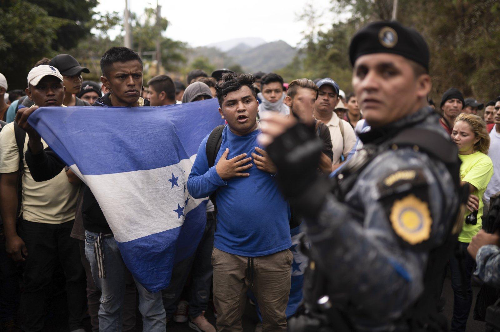 Honduran migrants hoping to reach the U.S. border are stopped at the Honduras border by Guatemalan police near Agua Caliente, Guatemala, Jan. 16, 2020. (AP Photo)