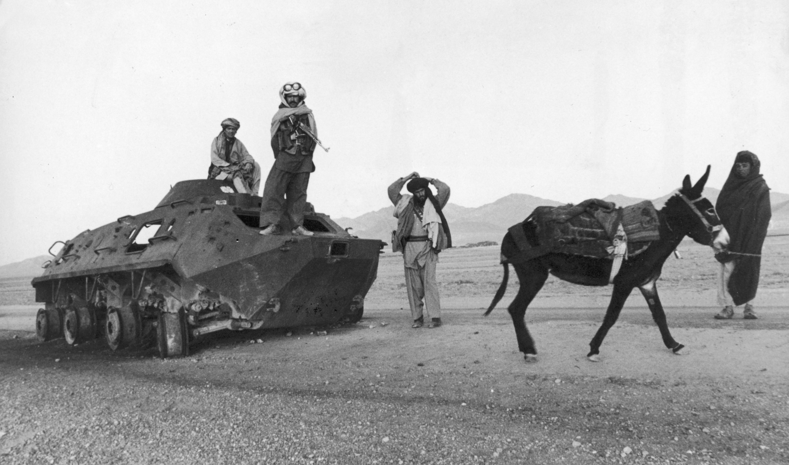 A group of Afghan soldiers with a Soviet Army tank stop in the desert with a donkey during the Afghan civil war, 1979. (Photo by Getty Images)