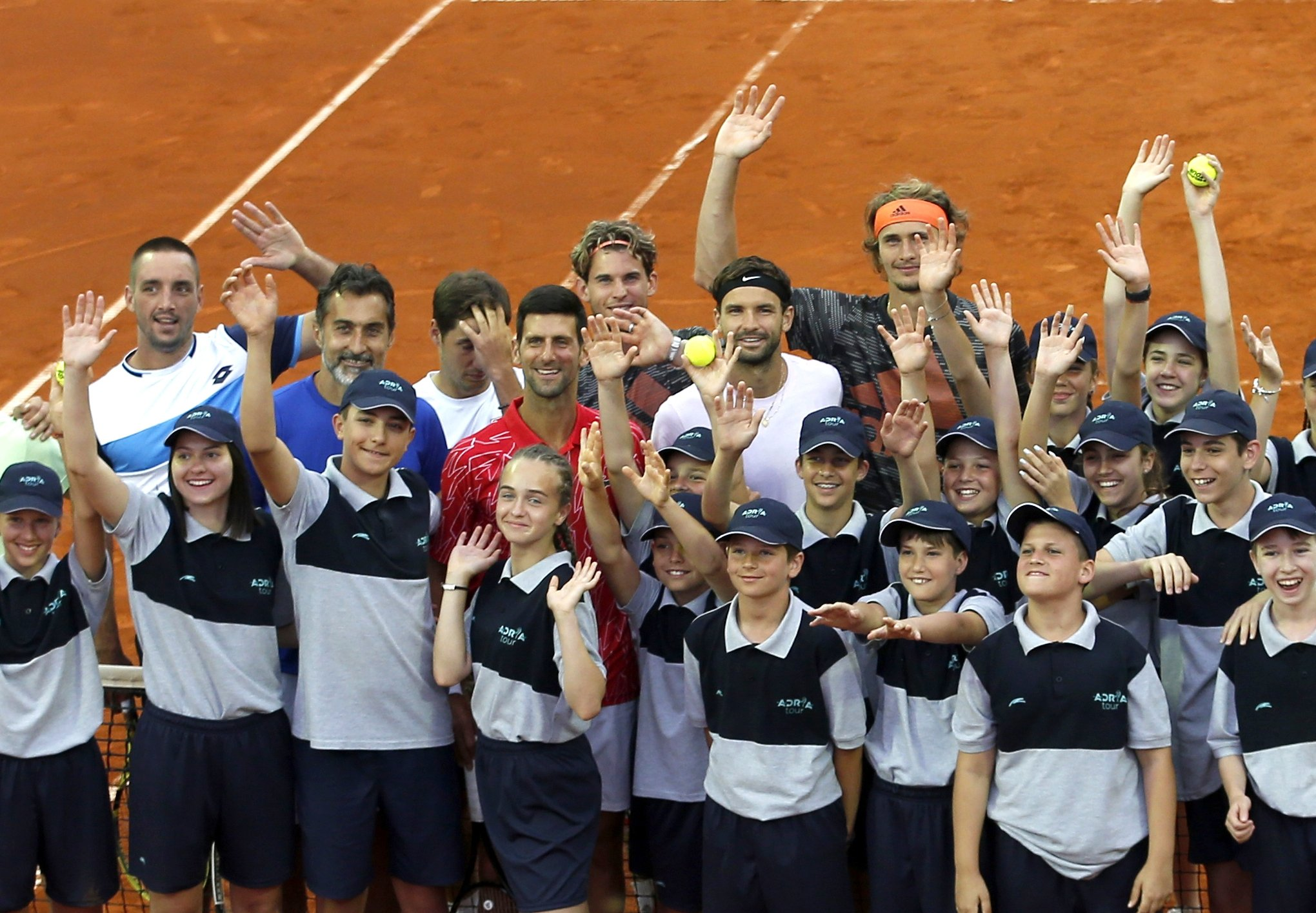 Serbia's Novak Djokovic (C) poses with volunteers and players during the Adria Tour charity tournament, in Belgrade Serbia, June 12, 2020. (AP Photo)