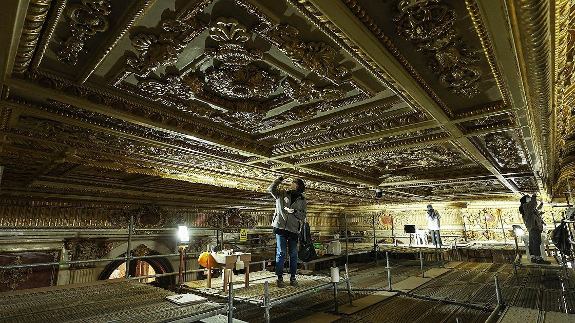 A restorer works on the ceiling of the Süfera Hall, Dolmabahçe Palace, Istanbul, Turkey, April 17, 2021. (AA Photo)