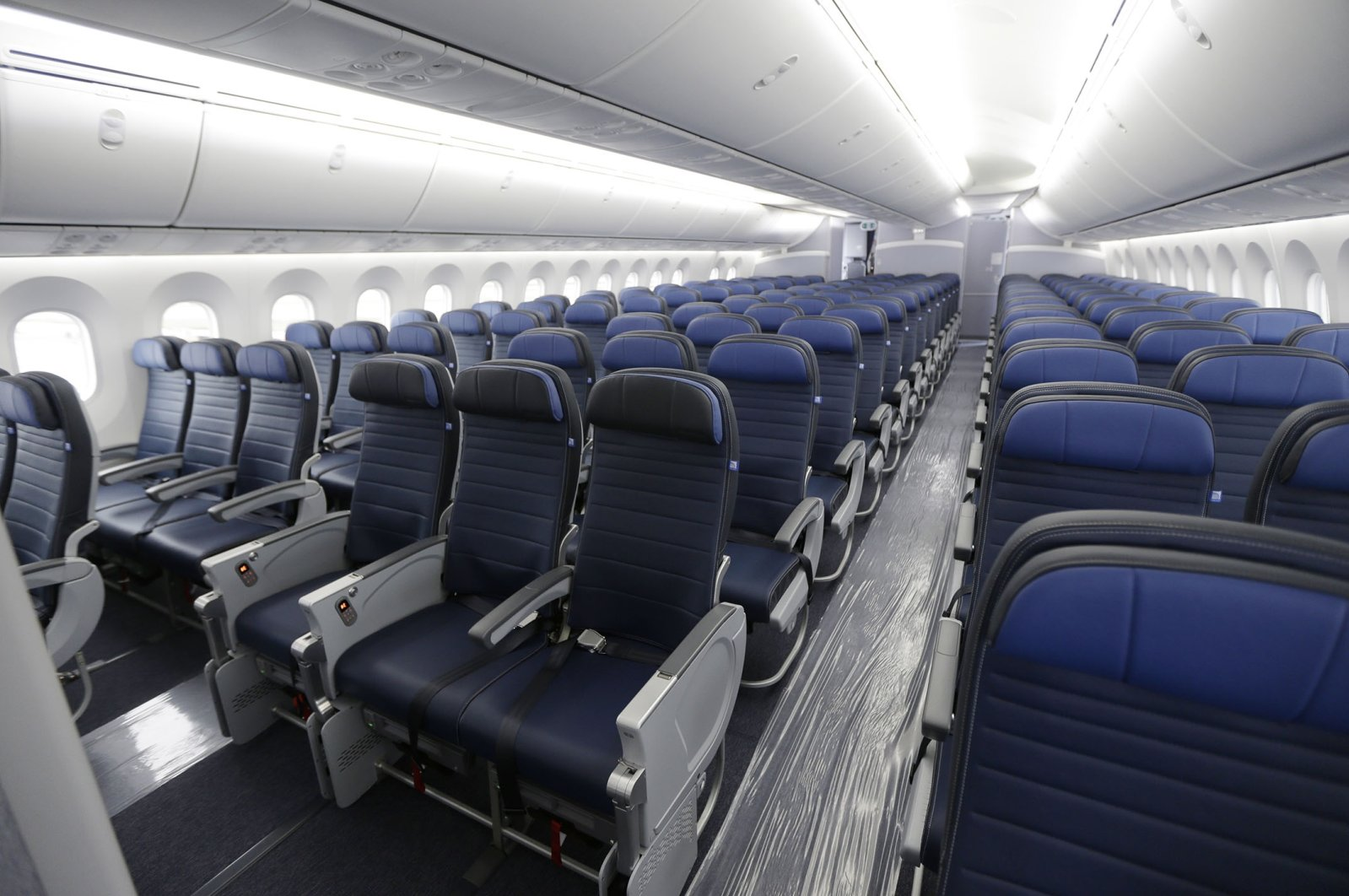 Economy class seating on a new United Airlines Boeing 787-9 undergoing final configuration and maintenance work at Seattle-Tacoma International Airport in Seattle, Washington, the U.S., Jan. 26, 2016. (AP Photo)