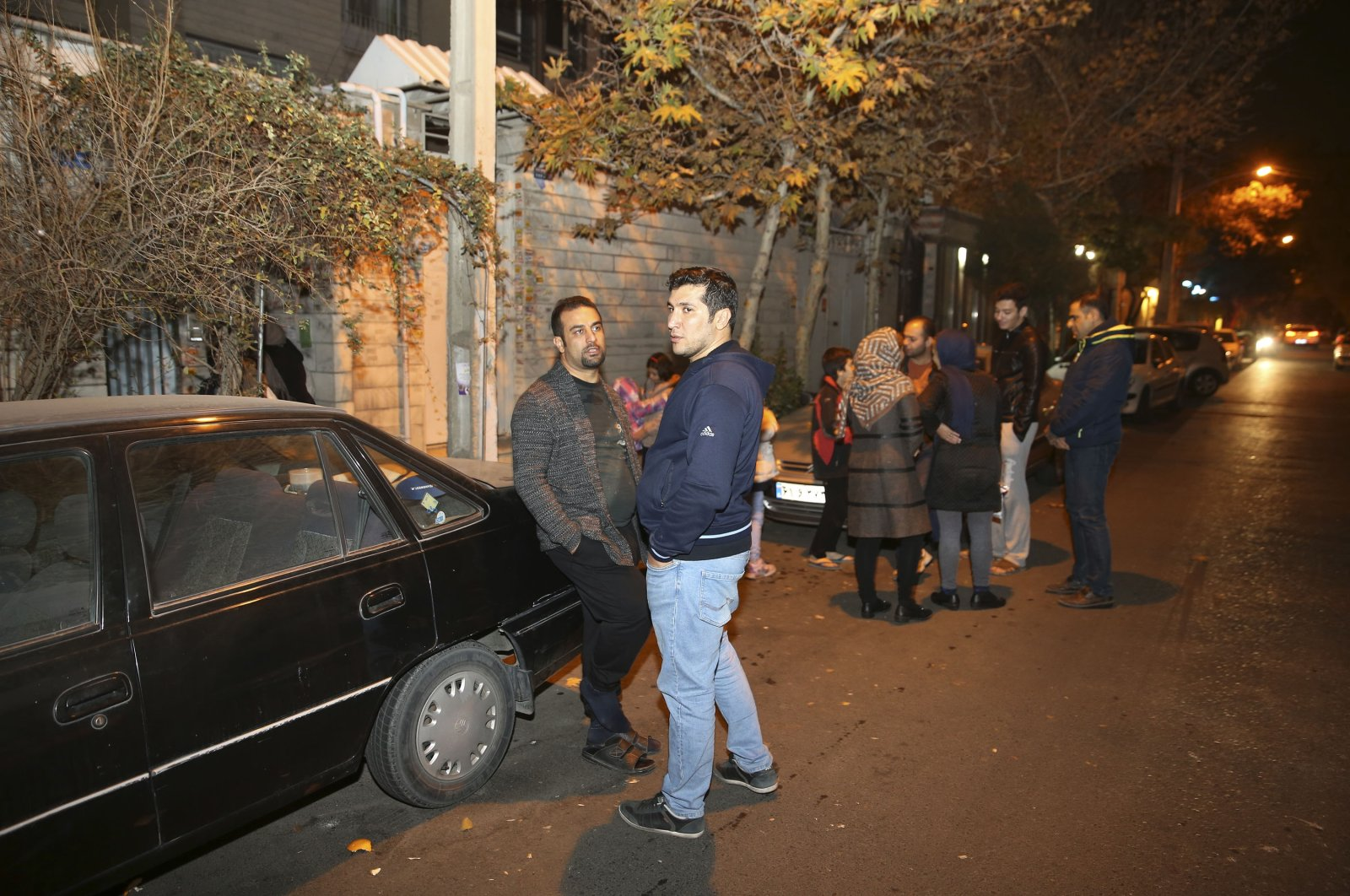 People stand outside their houses in Tehran after a late-night magnitude 5.2 earthquake jolted a town near Iran's capital, Dec. 21, 2017. (AP Photo)