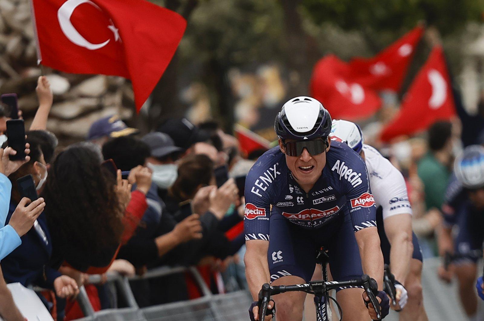 Belgium's Jasper Philipsen approaches the finish line of the 180-kilometer (111.8-mile) seventh stage between Marmaris and Turgutreis on the 56th Presidential Cycling Tour of Turkey, Turgutreis, southern Turkey, April 16, 2021. (AA Photo)