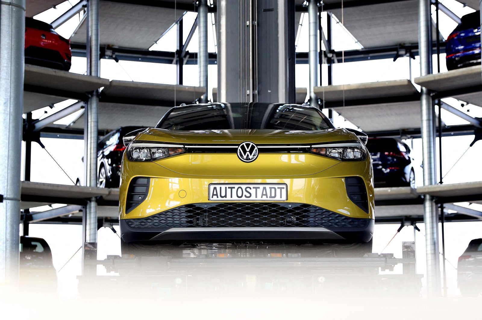 A new Volkswagen ID.4 SUV electric automobile is on display at the storage facility auto tower of German carmaker Volkswagen in Wolfsburg, northern Germany, March 26, 2021. (AFP Photo)