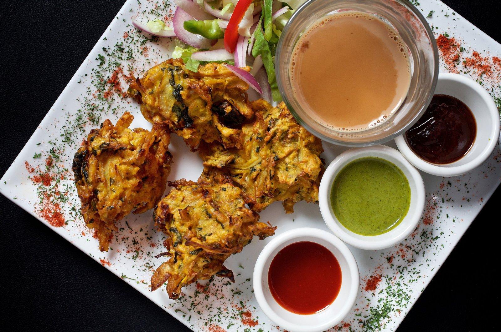 Garam garam pakora (mixed vegetable fritters) photographed at Bombay Street Food in Washington, DC, Dec. 13, 2018. (Getty Images).