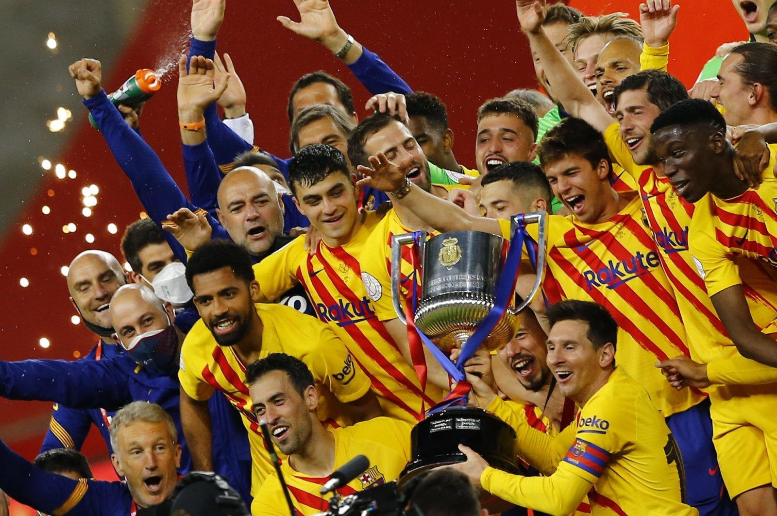 Barcelona's Lionel Messi and teammates celebrate winning the Copa del Rey with the trophy Estadio La Cartuja de Sevilla, Seville, Spain, April 17, 2021. (Reuters Photo)