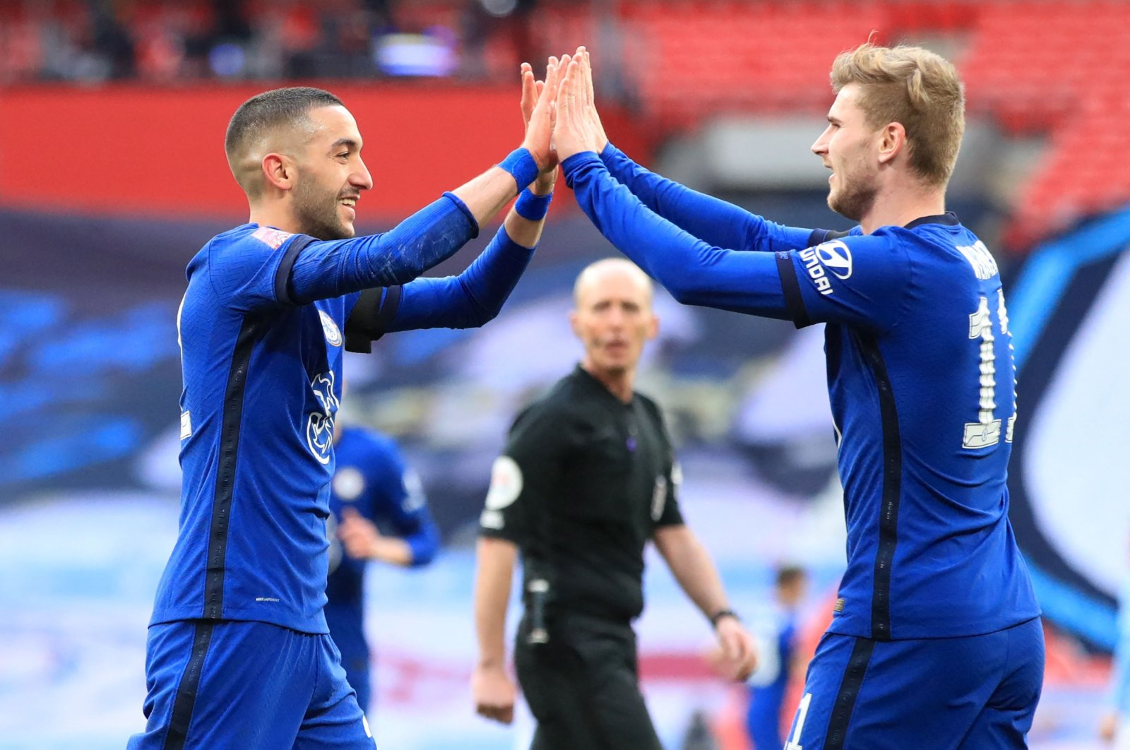 Chelsea's Moroccan midfielder Hakim Ziyech (L) celebrates with striker Timo Werner (R) after scoring the only goal in the English FA Cup semifinal against Manchester City at Wembley Stadium, London, Britain, April 17, 2021. (AFP Photo)