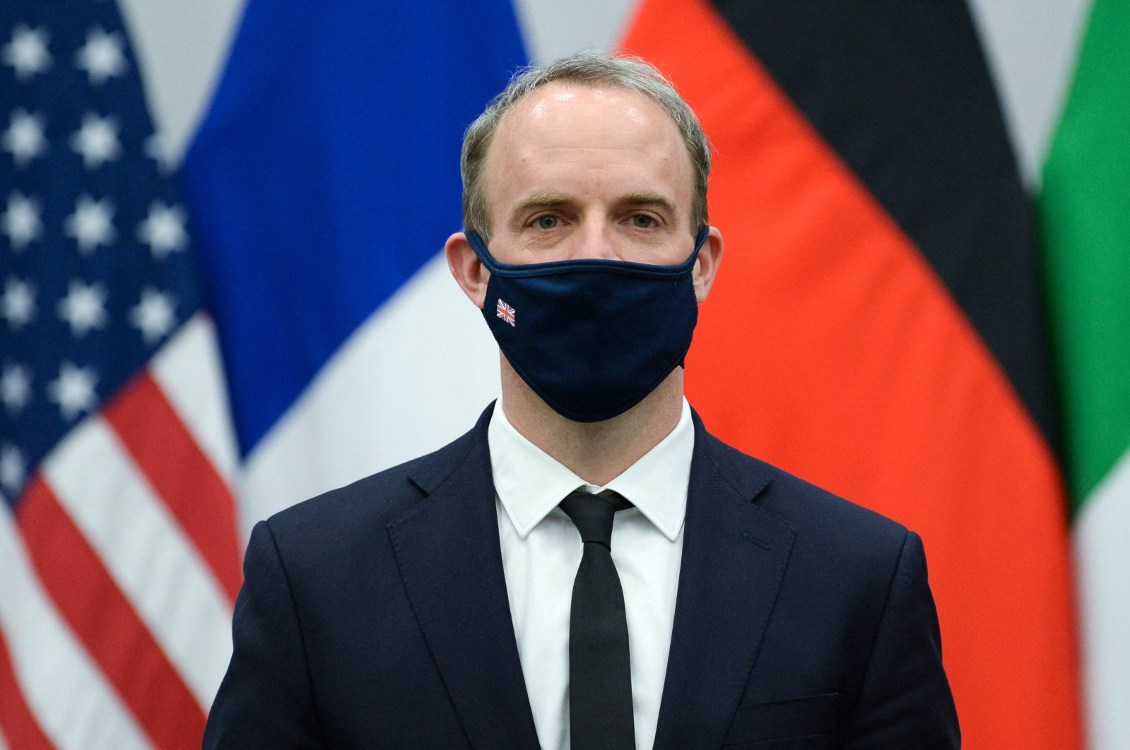 Britain's Foreign Secretary Dominic Raab wears a protective mask as he poses for a picture during a meeting at NATO's headquarters in Brussels, Belgium, April 14, 2021. (AFP Photo)