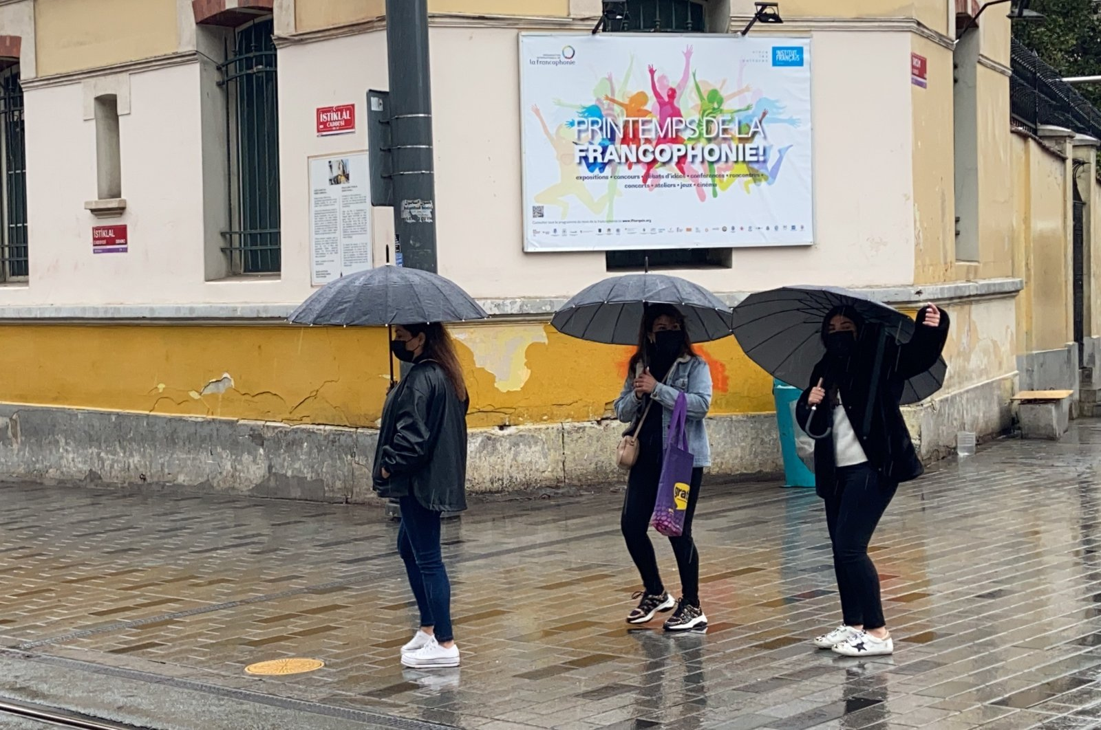 University students are seen standing in Istanbul's famous Istiklal Avenue during the COVID-19 pandemic in Istanbul, Turkey, April 17, 2021 (IHA Photo)