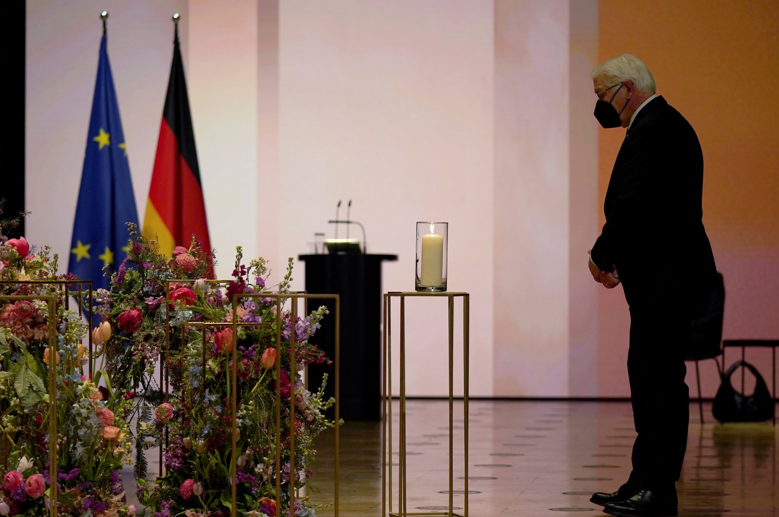 German President Frank-Walter Steinmeier stands next to a candle during a memorial ceremony for the victims of the COVID-19 pandemic, in Berlin, Germany, April 18, 2021. (Reuters Photo)